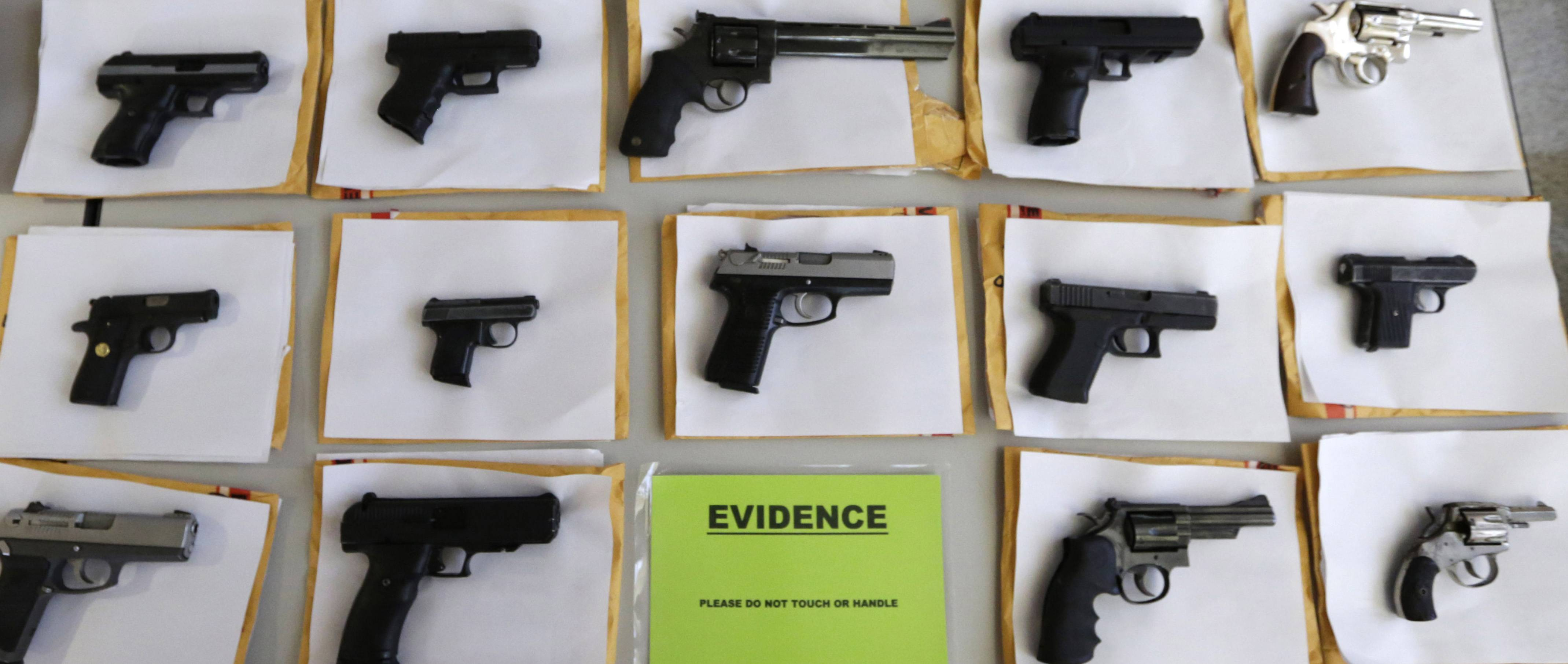 Chicago police display some of the nearly 3,400 illegal firearms the have confiscated so far this year.