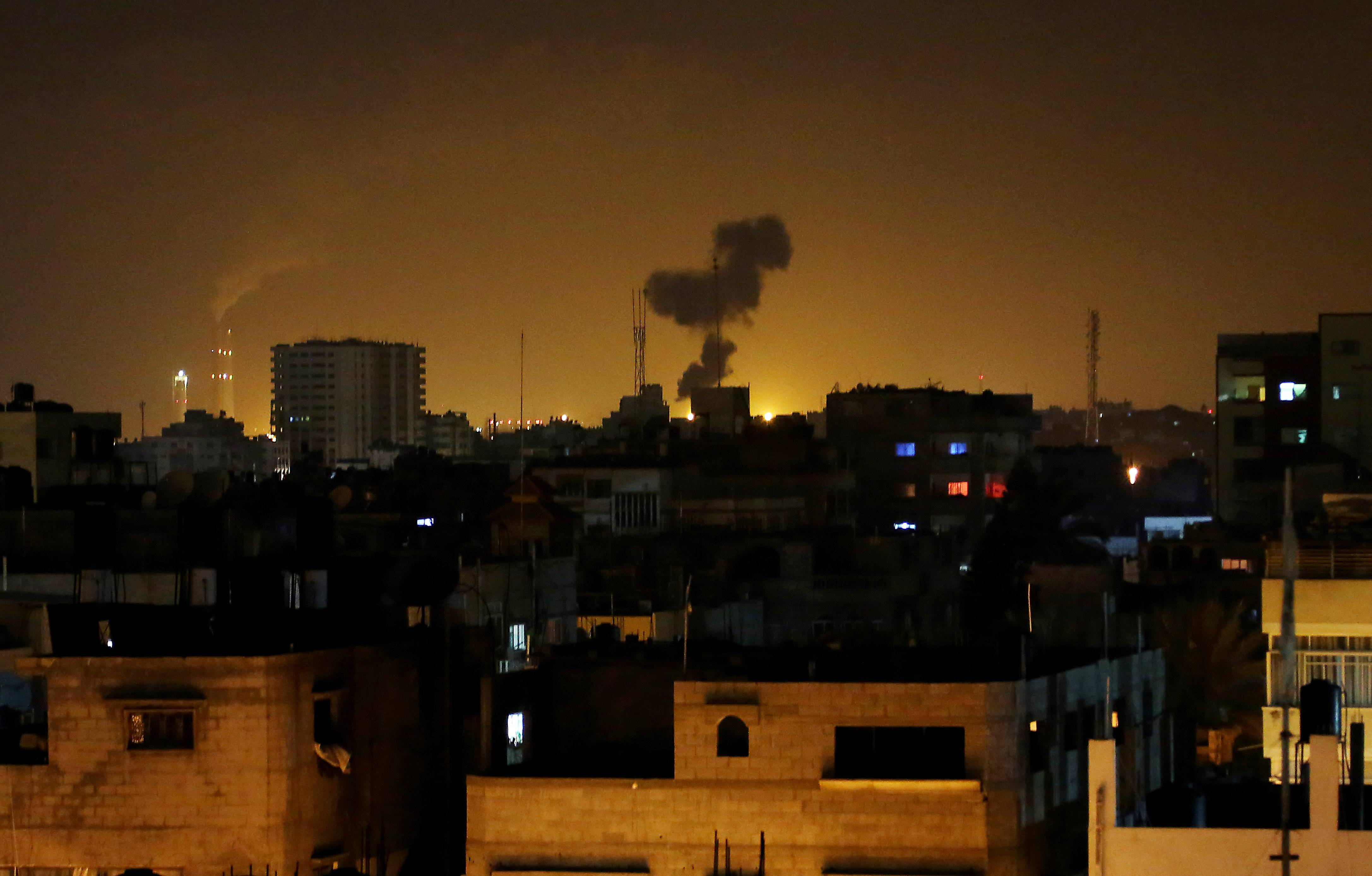 Smoke rises after an Israeli missile strike in Beit Lahia, northern Gaza Strip, Monday. Hamas vowed revenge on Israel for the death of seven of its members killed in the airstrike.