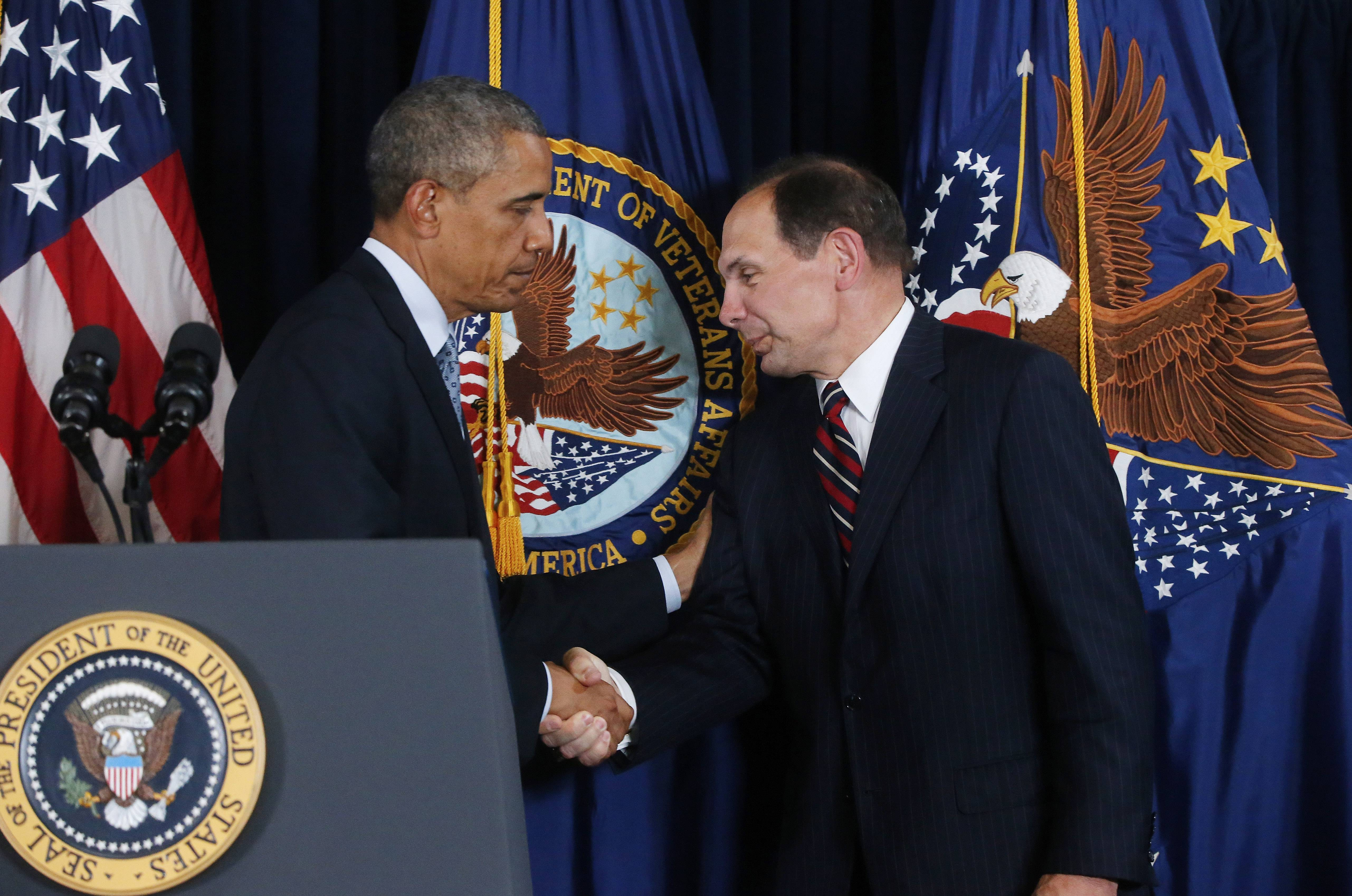 President Barack Obama shakes hands with former Procter & Gamble CEO Robert McDonald, his nominee as the next Veterans Affairs secretary, at the Department of Veterans Affairs in Washington D.C. on June 30. McDonald spent his formative years in Arlington Heights.
