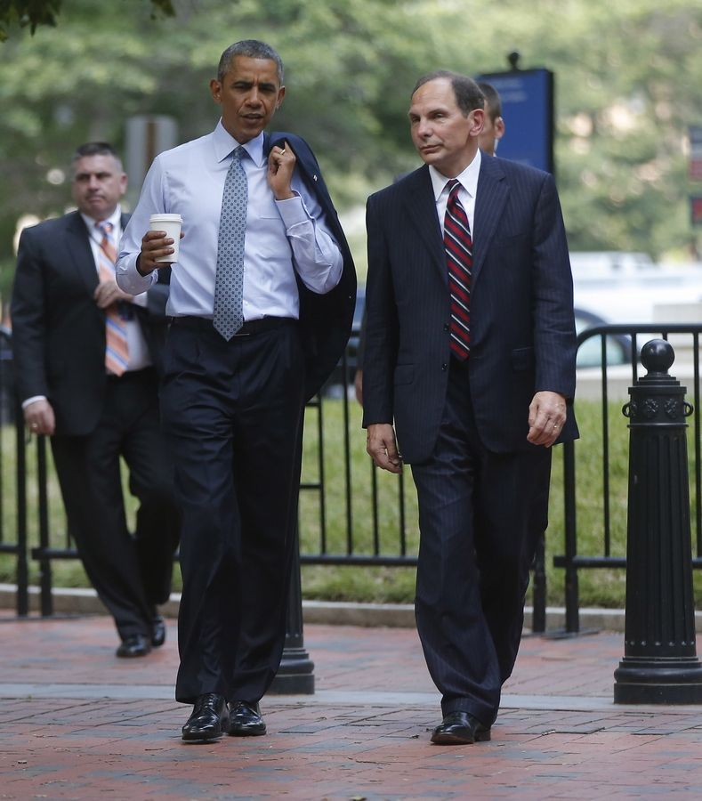 President Barack Obama walks with former Procter & Gamble executive Robert McDonald, the nominee as the next Veterans Affairs secretary, from the Department of Veterans Affairs across Lafayette Park back to the White House in Washington D.C.