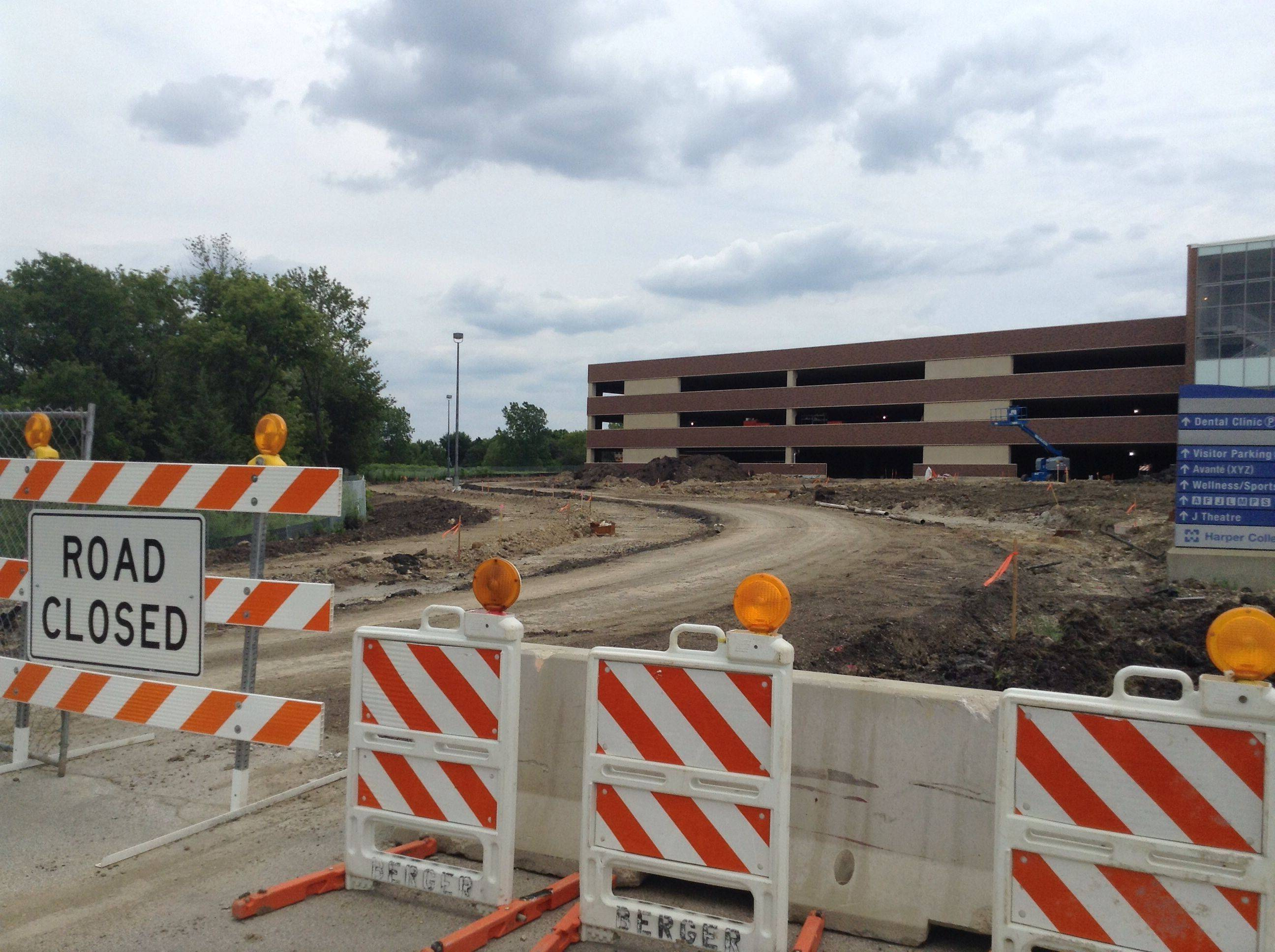 Harper College will charge students and faculty to park inside a new $14 million parking garage on the east side of the Palatine campus. The first two levels of the four-story structure are scheduled to open Aug. 25, with the top floors expected to be ready in mid-October.