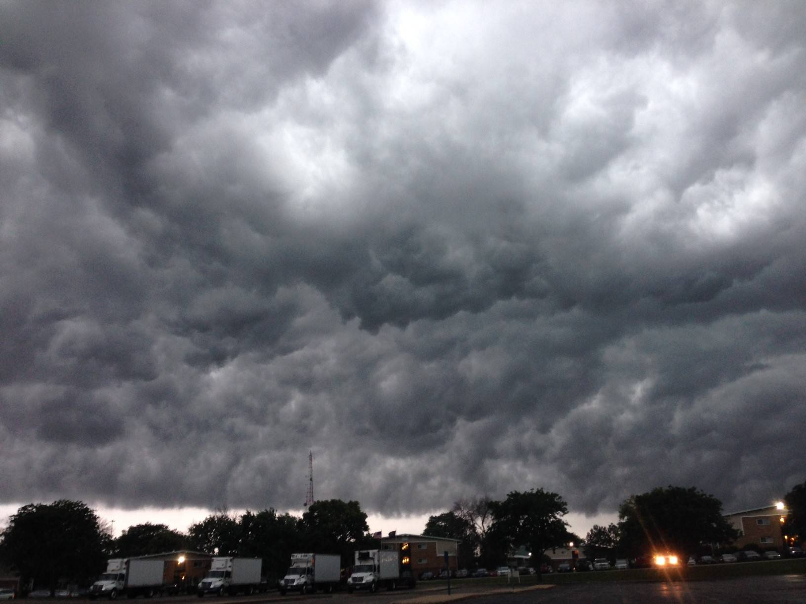 Storm clouds arrive near the intersection of Algonquin Road and Route 53 along the Palatine-Rolling Meadows border.