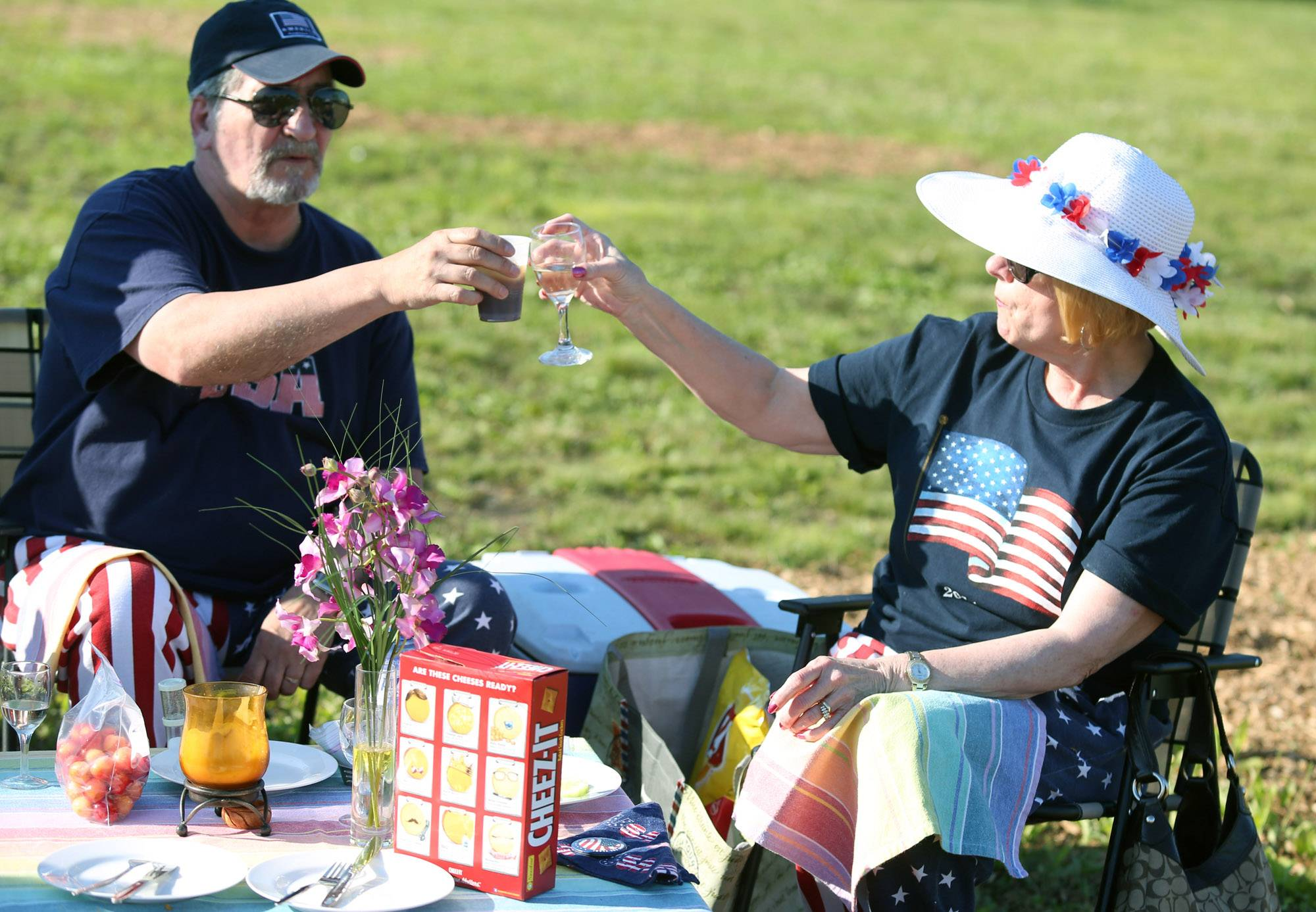 Robert Degelmann, of Wheeling, toasts with his wife, Joyce, at Evening Under the Stars as DJ Alberto Toro plays music on Friday outside of Wheeling Village Hall.