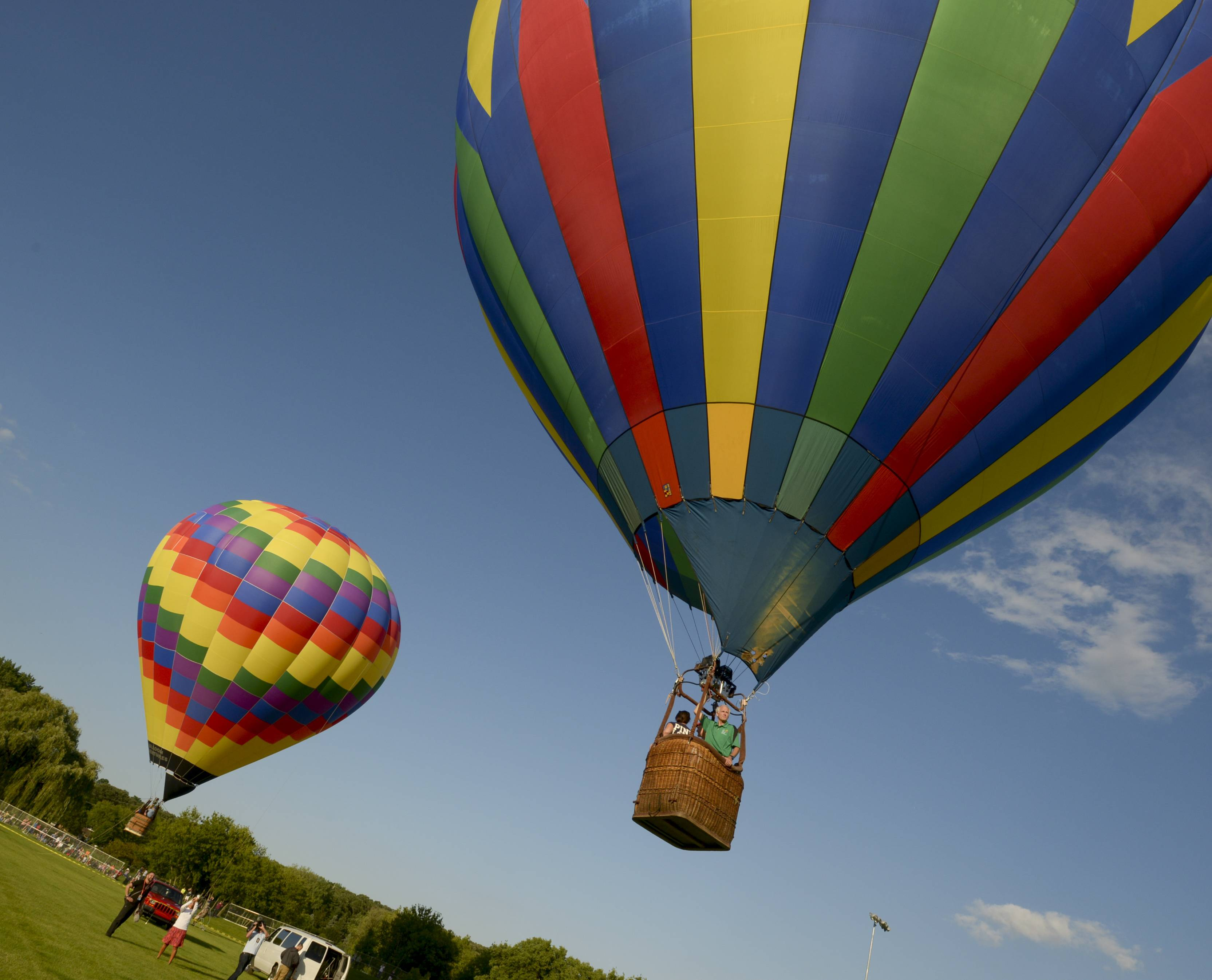 Hot-air balloons head into the sky on the first full day of Eyes to the Sky festival in Lisle.