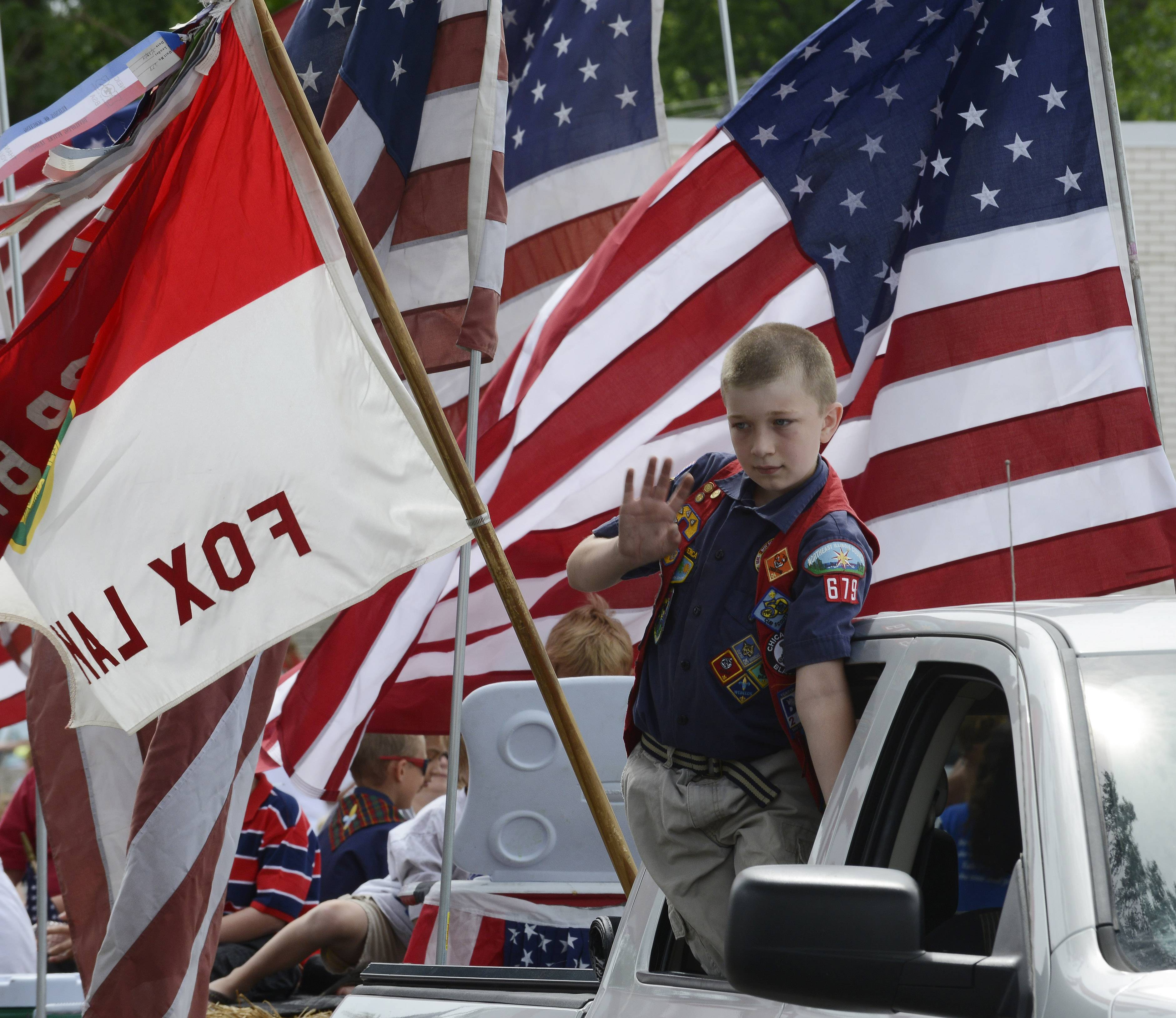 Bradley Berd, 10, of Cub Scout Pack 679, rides in Saturday's parade in Fox Lake.