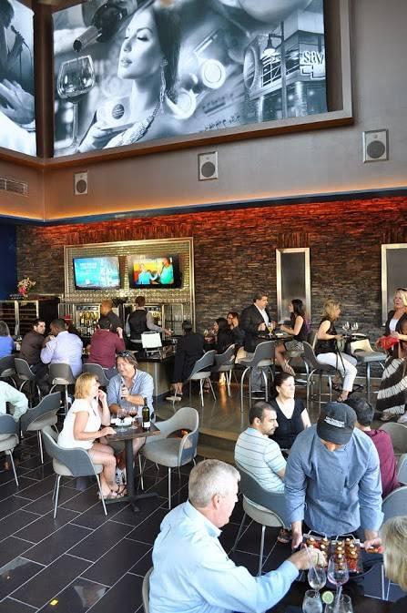 Linger over a cup of coffee during the day — or a chardonnay at night — at the new Say Beignet Coffee & Wine Bar in Bolingbrook.