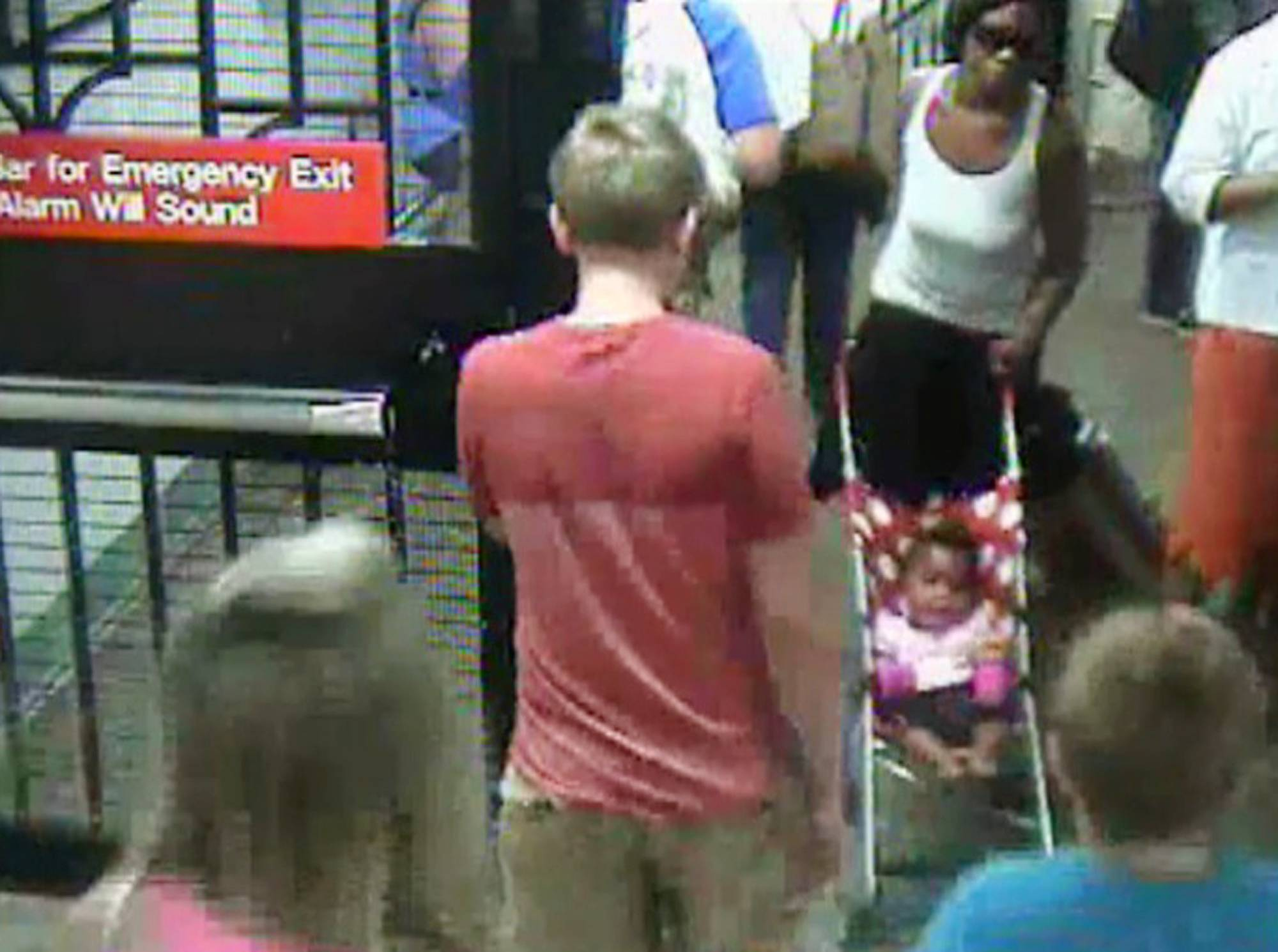 In this Monday, July 7, 2014 surveillance camera image provided by the New York Police Department, a woman, top right, pushes her baby girl in a stroller at the Columbus Circle subway station in New York. The 20-year-old woman, who is suspected of abandoning the baby at the Manhattan station, was in police custody on Tuesday.