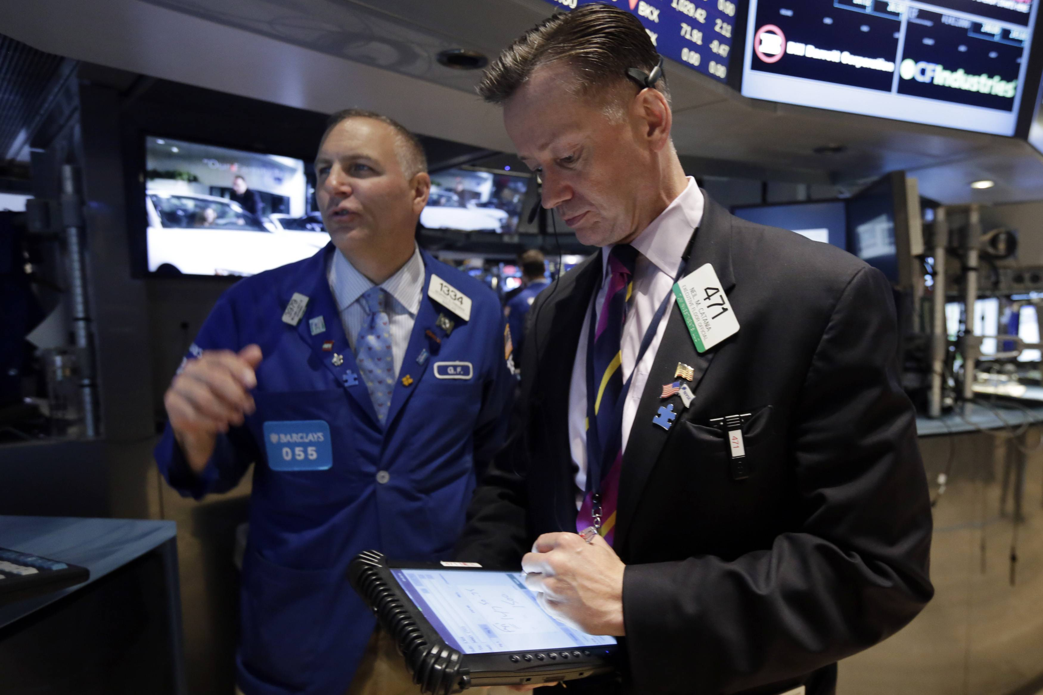 Investors sold stocks broadly for a second day on Tuesday as they wait for corporate earnings reports to see whether a recent run-up in prices is justified. The Dow Jones industrial average closed below 17,000, a key level it topped last week for the first time in its 118-year history.