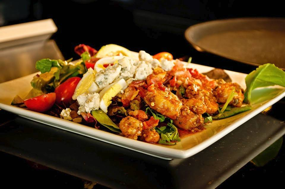 Say Beignet's Shrimp Cobb salad features blackened shrimp with romaine, grape tomatoes, hard-boiled egg, avocado, bacon and blue cheese, topped with a spicy ranch dressing.