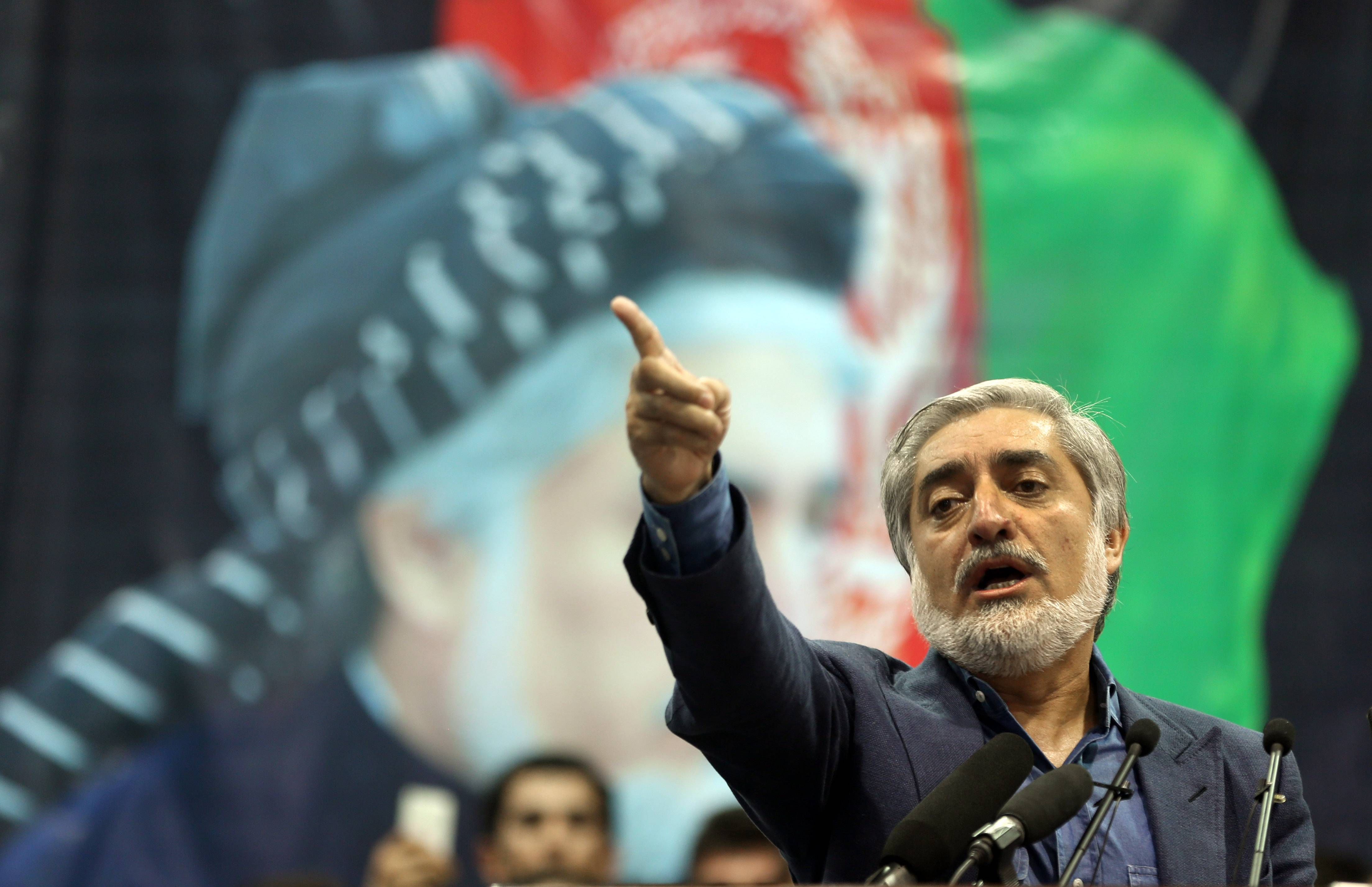 Afghan presidential candidate Abdullah Abdullah speaks during a gathering of his supporters in Kabul on Tuesday. Abdullah says he received calls from President Barack Obama and U.S. Secretary of State John Kerry after he refused to accept the preliminary result of the vote citing fraud.
