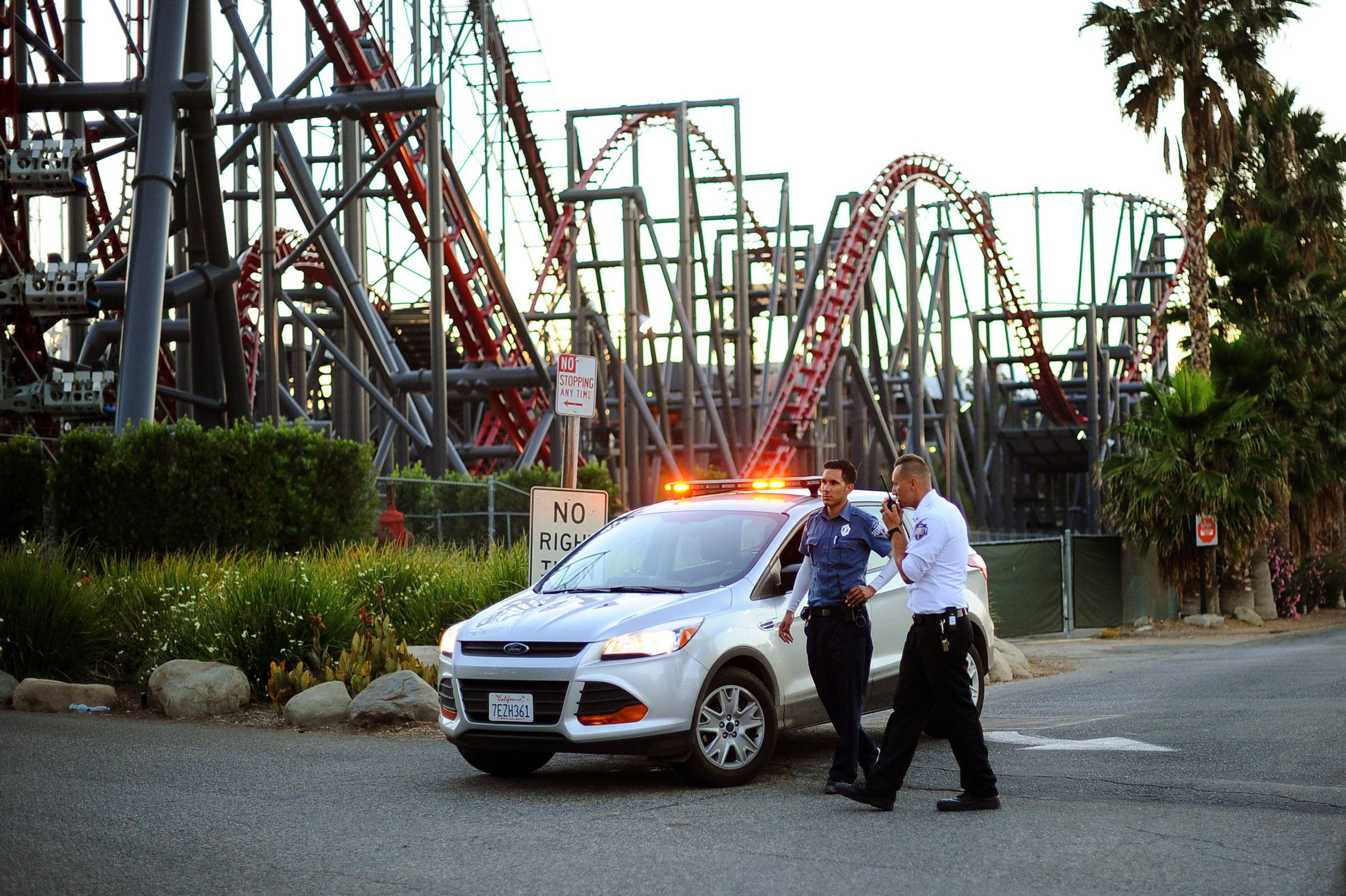 Six Flags Magic Mountain's Ninja roller coaster hit a tree branch dislodging the front car, leaving four people slightly injured and keeping nearly two dozen summer fun-seekers hanging 20 to 30 feet in the air for hours as day turned to night.