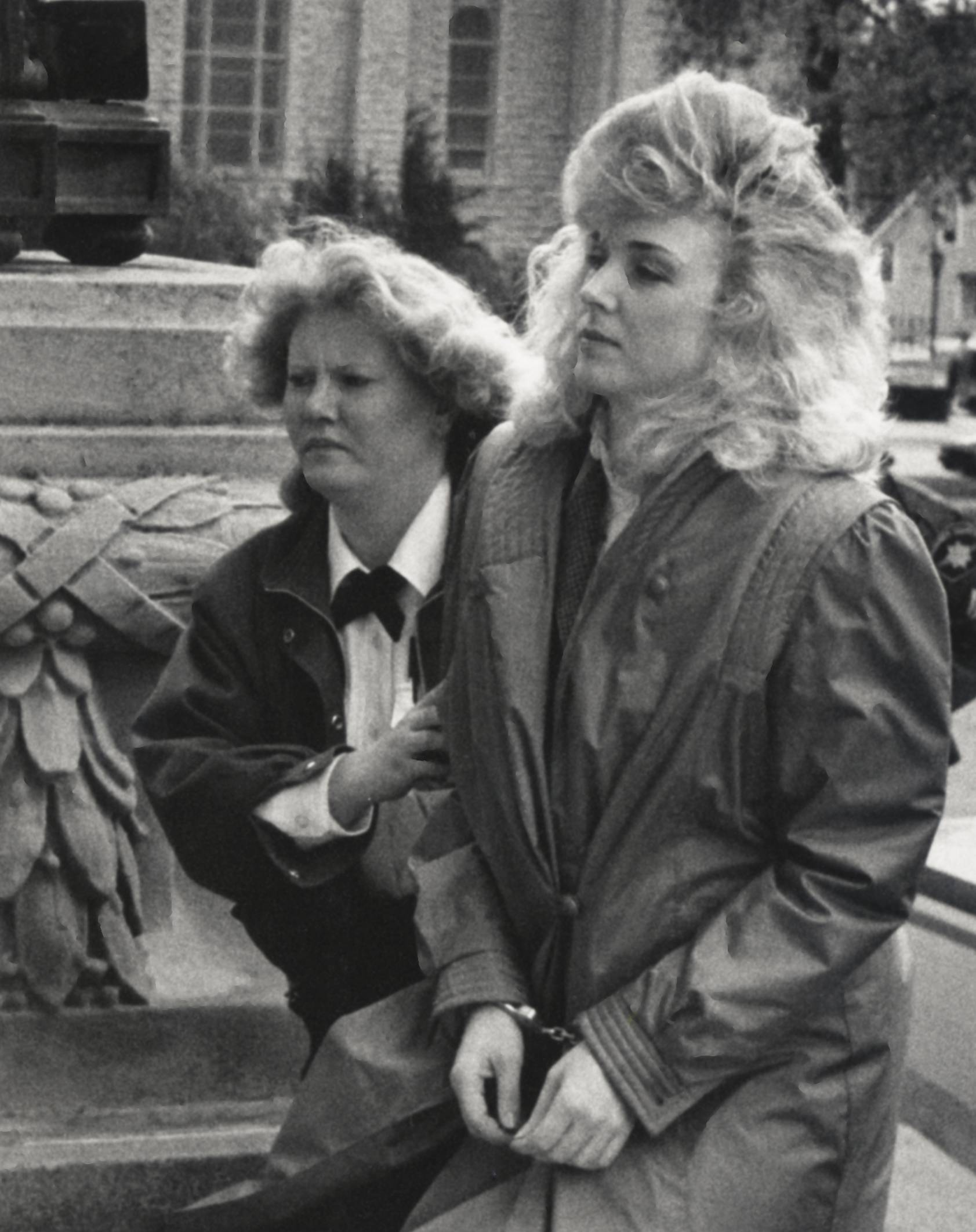 Nancy Rish, right, is escorted outside the Kankakee courthouse during her trial in 1988.