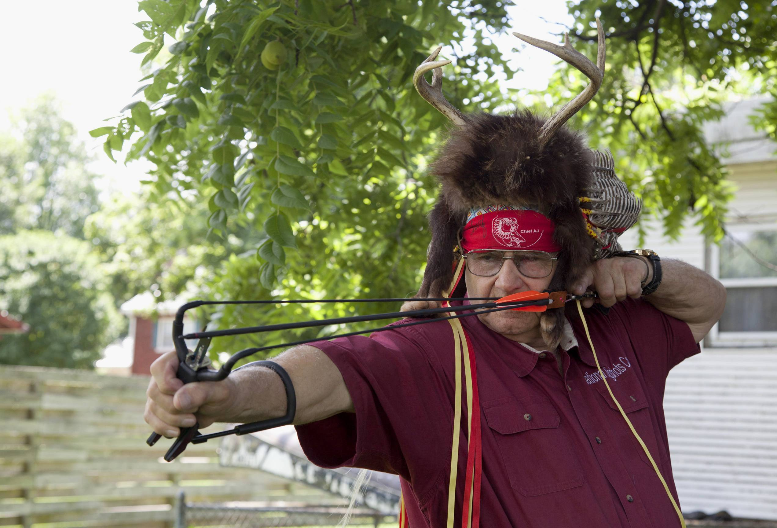 "John ""Chief A.J."" Huffer, 76, demonstrates firing an arrow with his slingshot in Tuscola, Ill."