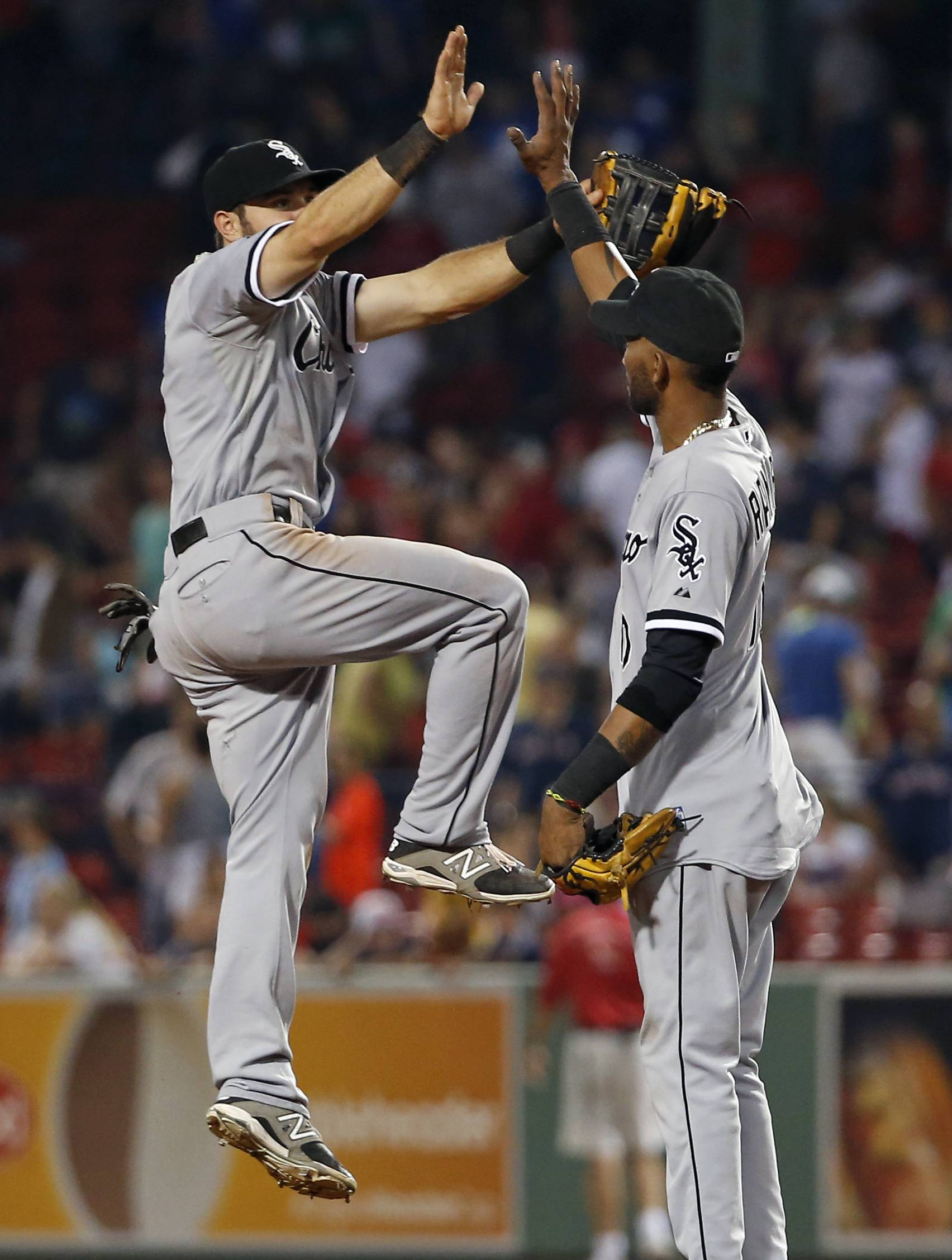 Adam Eaton, left, celebrates with Alexei Ramirez after the White Sox' victory over the Red Sox on Tuesday night.