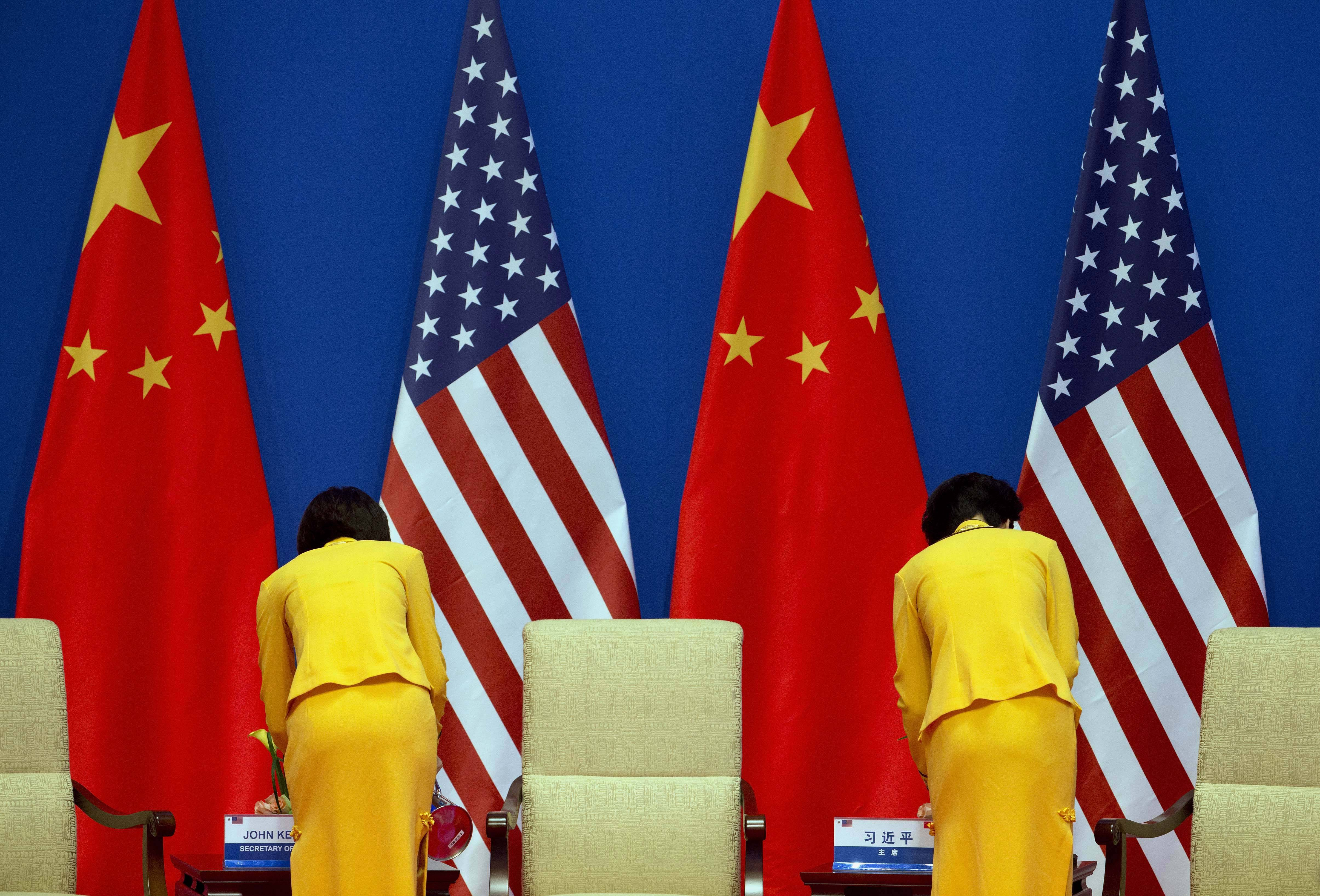Chinese hostesses prepare tea for U.S. Secretary of State John Kerry and Chinese President Xi Jinping before the opening ceremony of the sixth U.S.-China. Strategic and Economic Dialogue and the fifth round of the China-U.S. High Level Consultation on People-to-People Exchange.