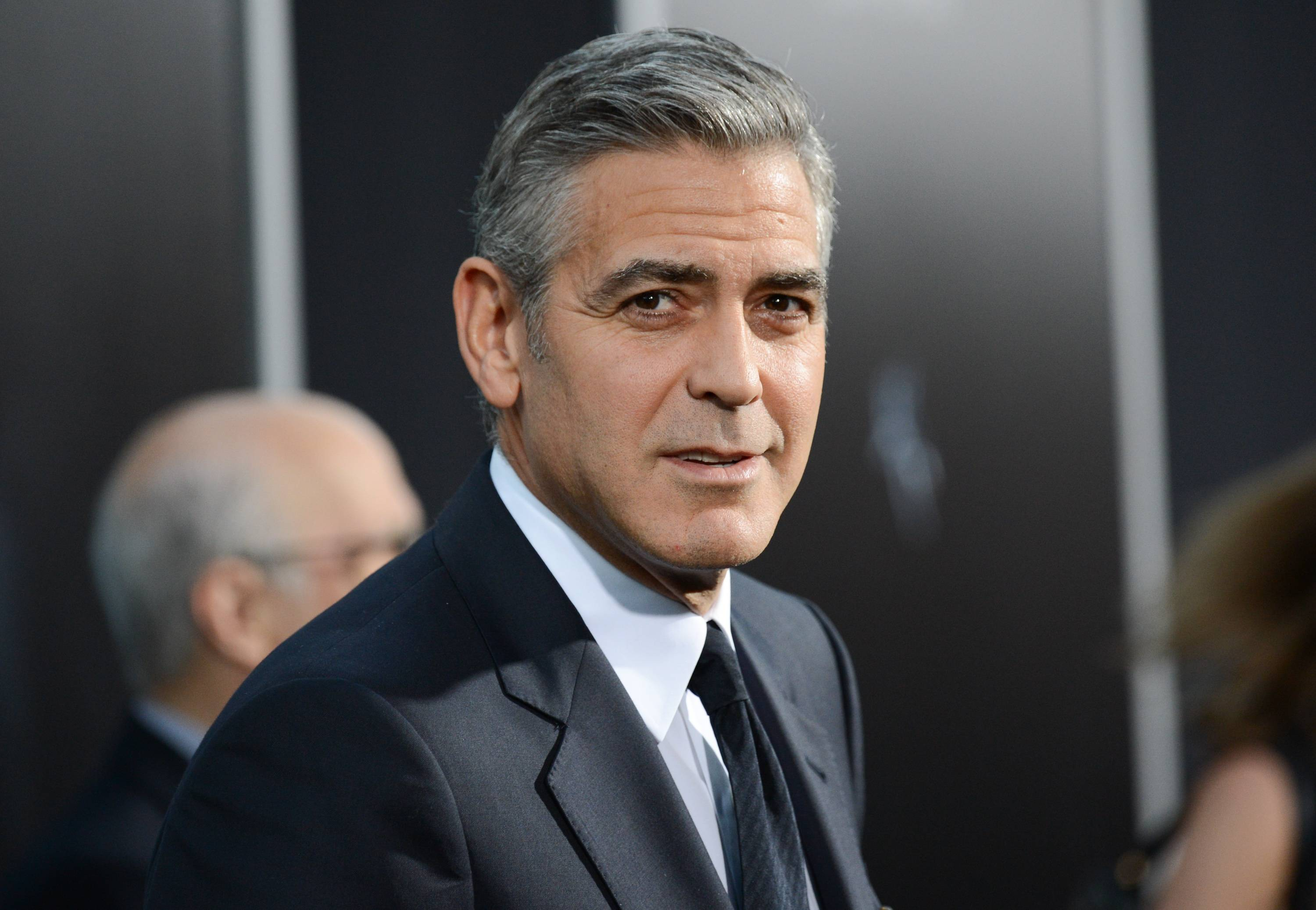 George Clooney has chastised a British newspaper over an article claiming his fiancee's mother disapproves of the impending marriage for religious reasons. Clooney said that the claims about his future mother-in-law Baria Alamuddin were untrue and irresponsible.
