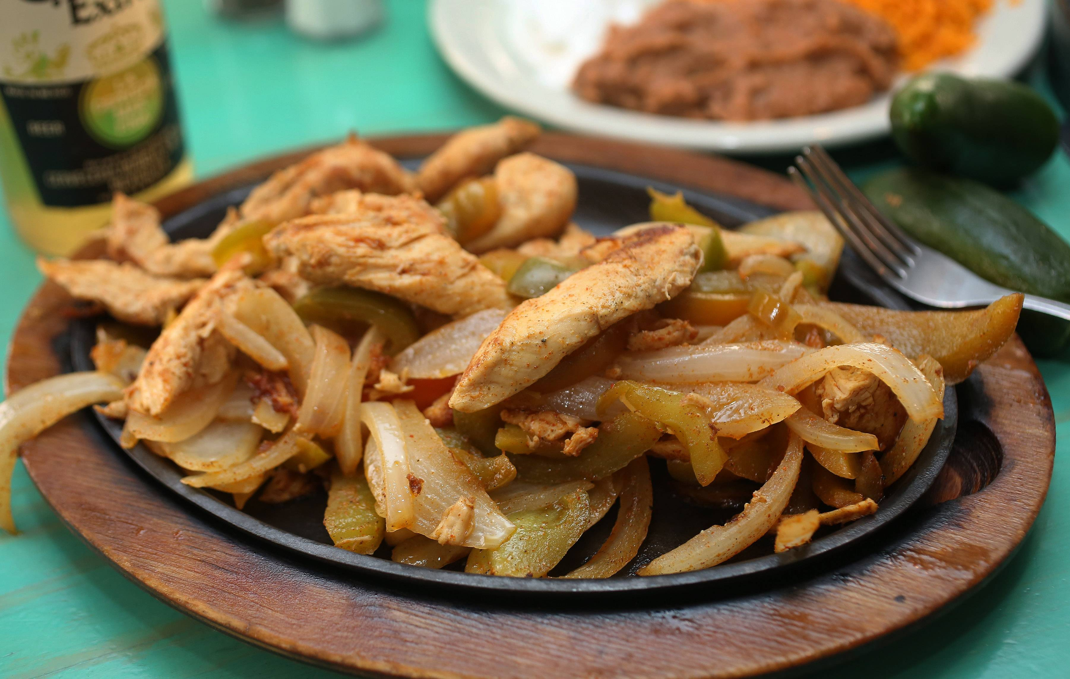 Chicken fajitas come sizzling hot at El Puerto in Fox Lake. Ask for additional tortillas right away, as the meat and vegetable portion is generous.