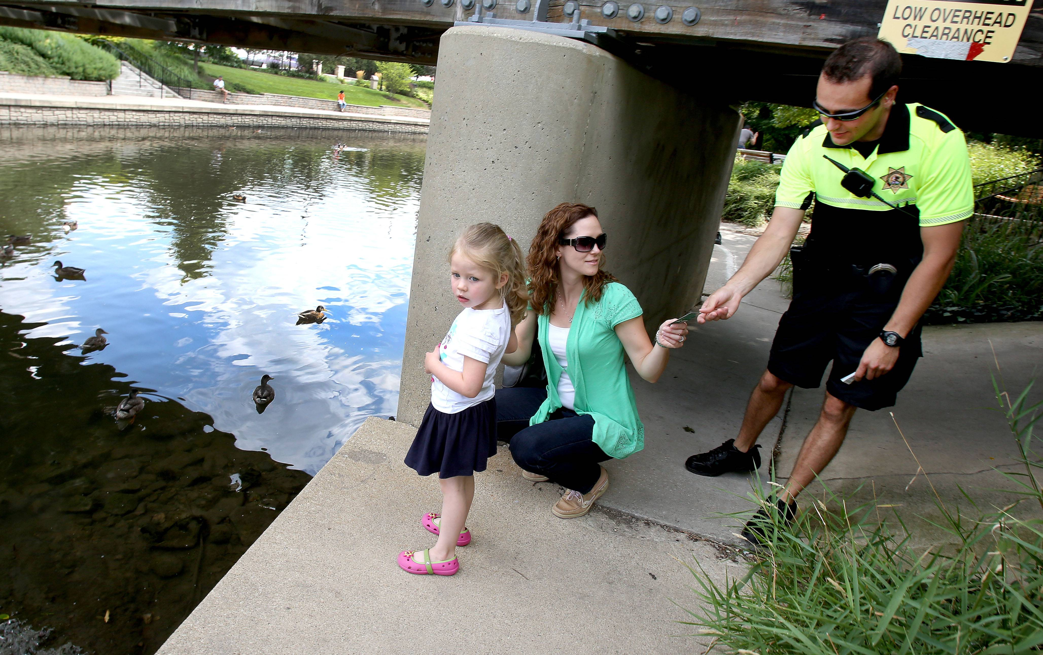 A Naperville resident is suggesting a group of volunteers be formed to join Naperville Park District police in educating the public about the hazards of feeding ducks and geese along the Riverwalk. Park district police officers have been handing out River Wildlife Cards with facts about the harmful effects of human food on waterfowl for almost a year.