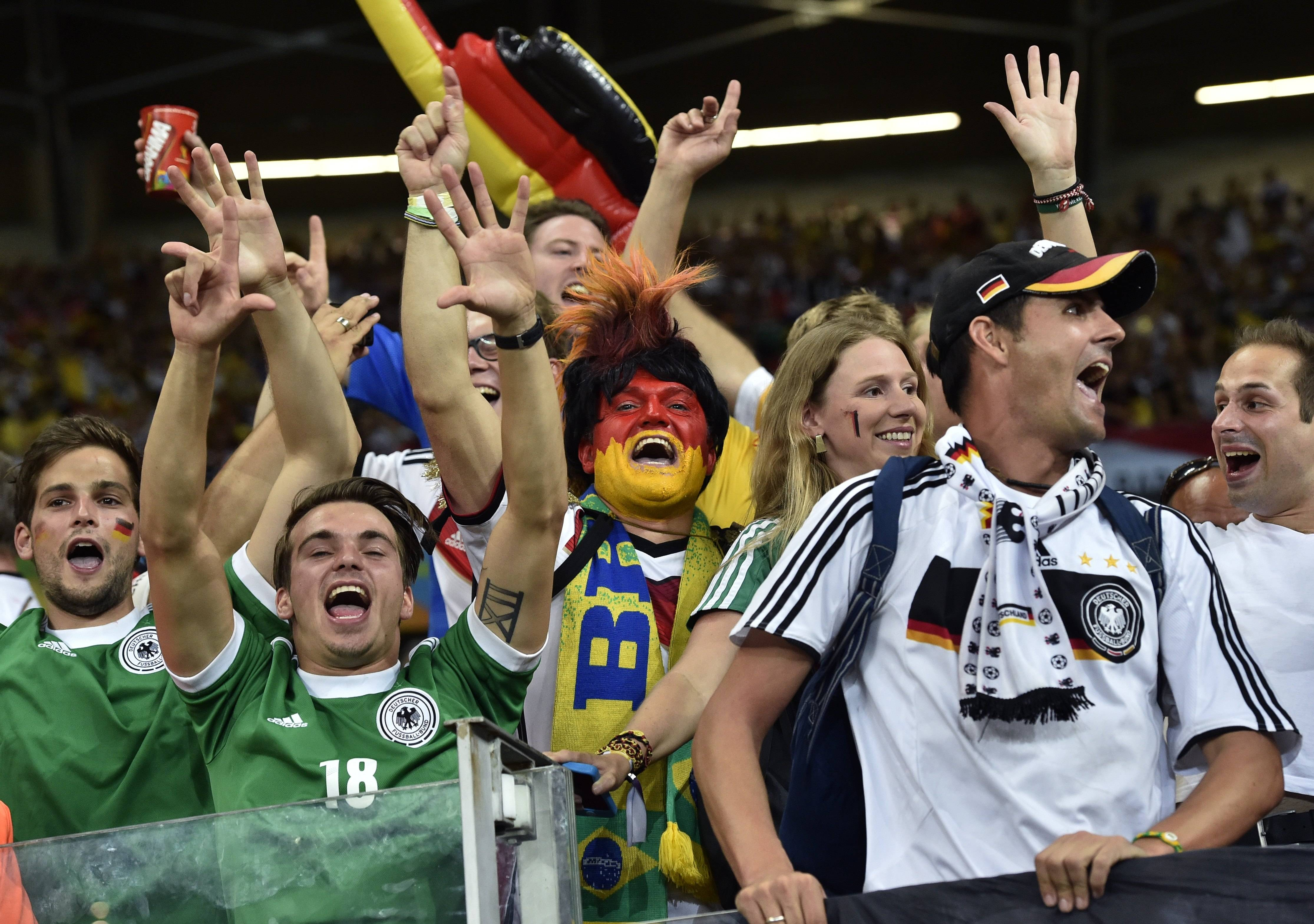German supporters celebrate after the World Cup semifinal soccer match between Brazil and Germany at the Mineirao Stadium in Belo Horizonte, Brazil, Tuesday, July 8, 2014. Germany won the match 7-1.