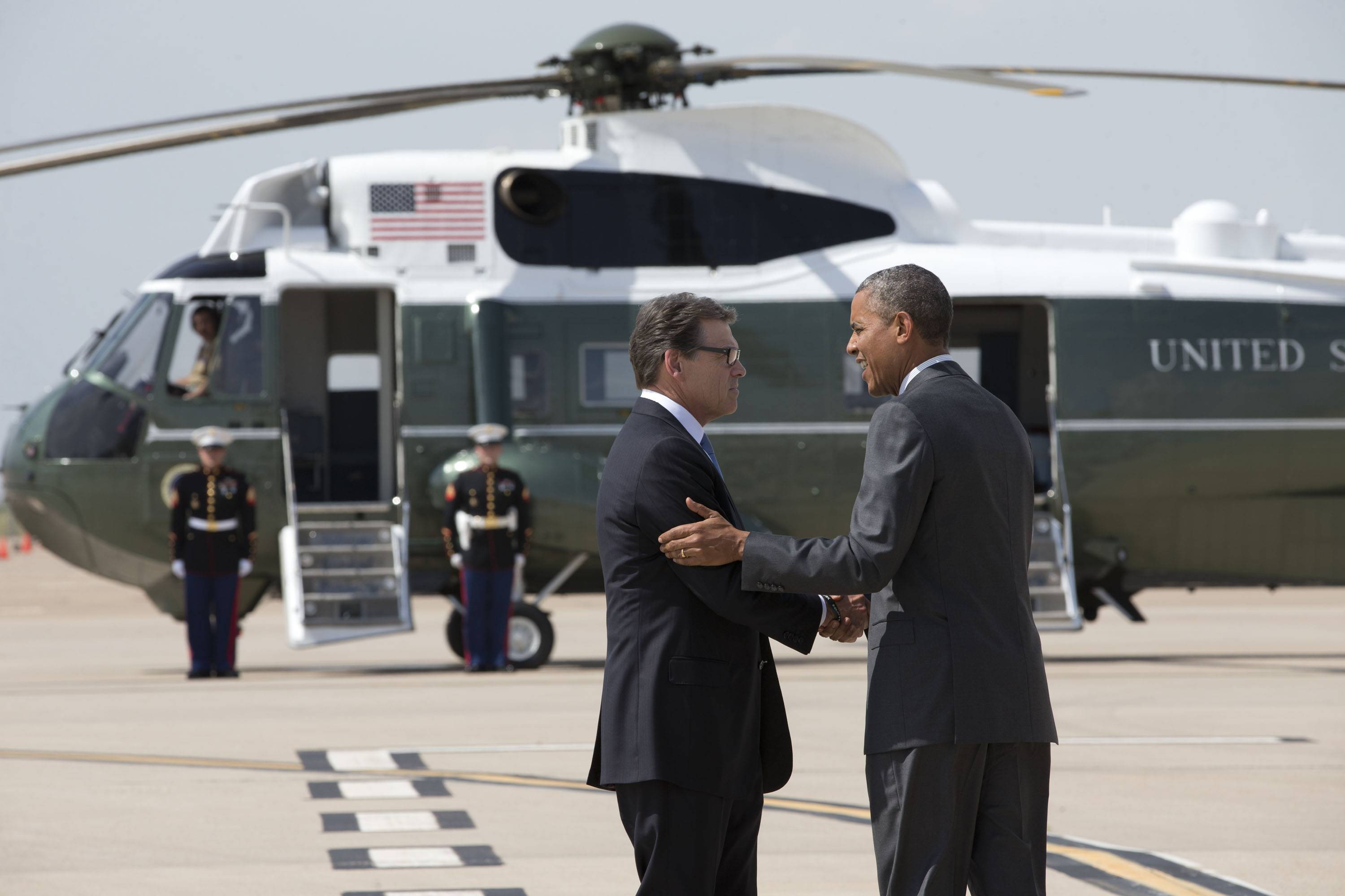 President Barack Obama, seen greeting Texas Gov. Rick Perry as he arrives at Dallas/Fort Worth Wednesday, pleaded with Congress to immediately pass an emergency funding request to deal with a flood of migrant children at the U.S. border and urged Perry to pressure fellow Republicans to get it done.