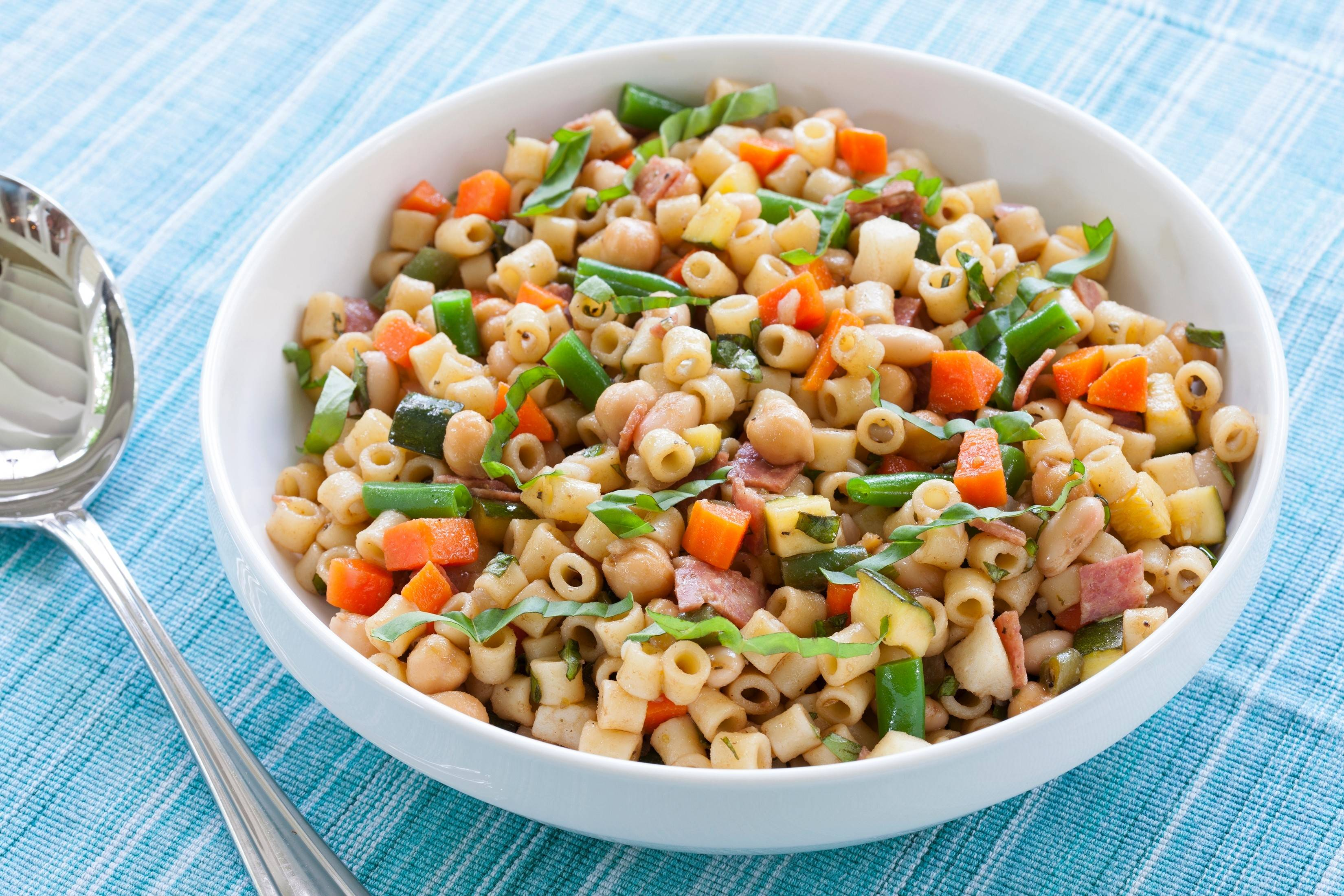 The flavors of your favorite cold-weather soup come together in a summer Minestrone Pasta Salad.