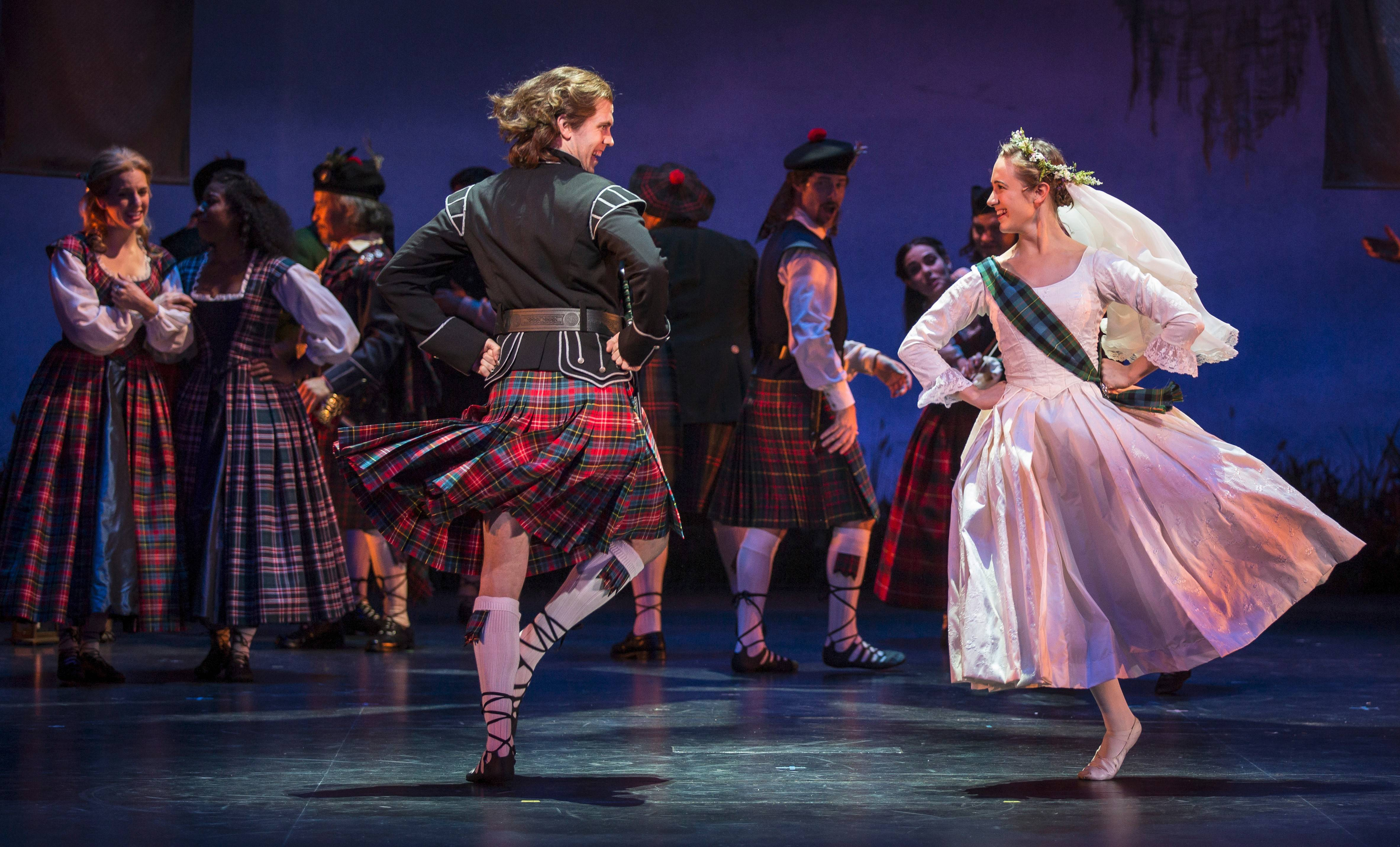 "Charlie Dalrymple (Jordan Brown) dances with his bride, the bonny Jean (Olivia Renteria), in Goodman Theatre's stellar revival of the musical ""Brigadoon."""