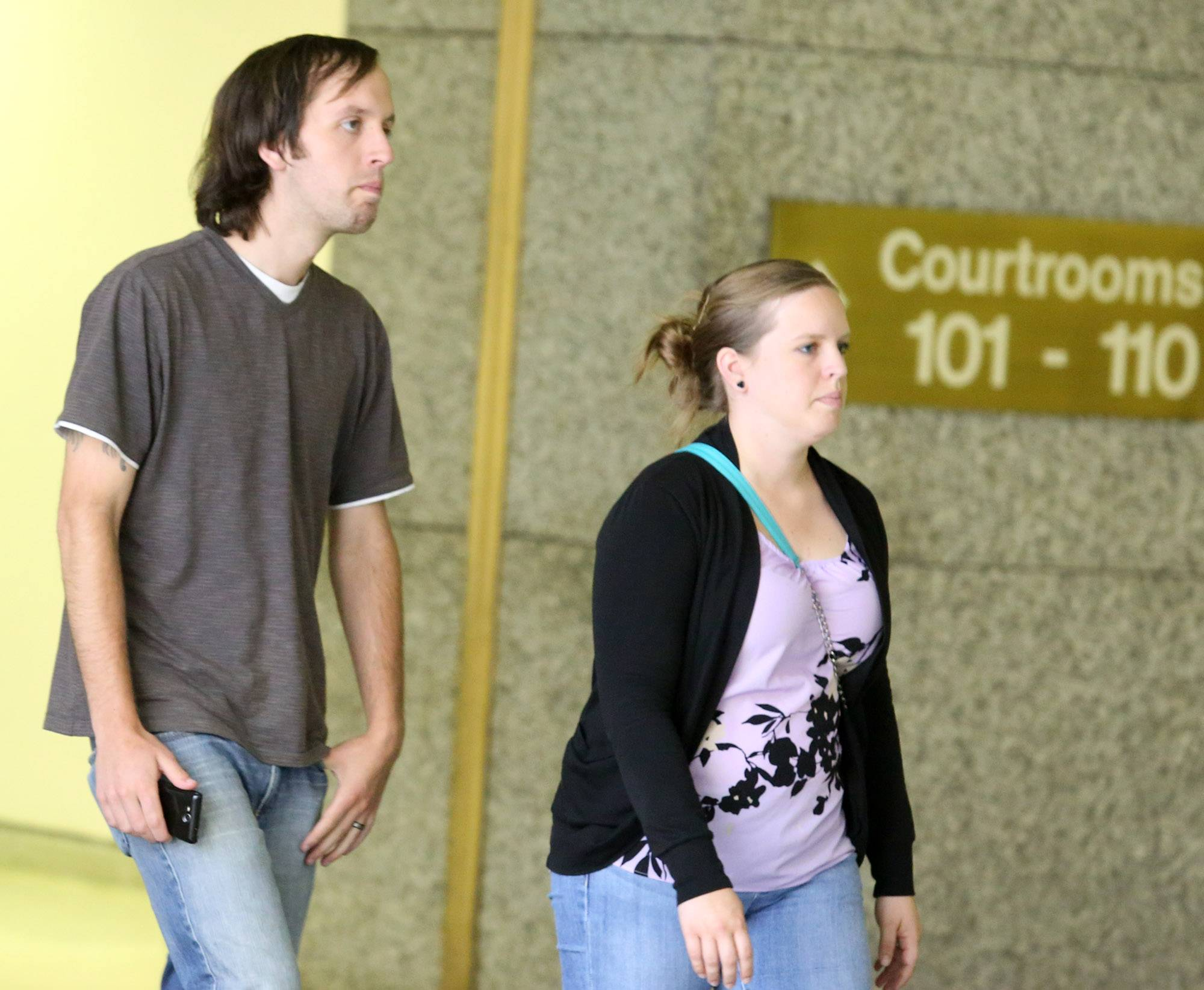 Jeff Engelhardt and his wife arrive at the Cook County courthouse in Rolling Meadows for the sentencing Wednesday of D'Andre Howard, the man convicted of killing three members of the Engelhardt family in 2009 in Hoffman Estates.