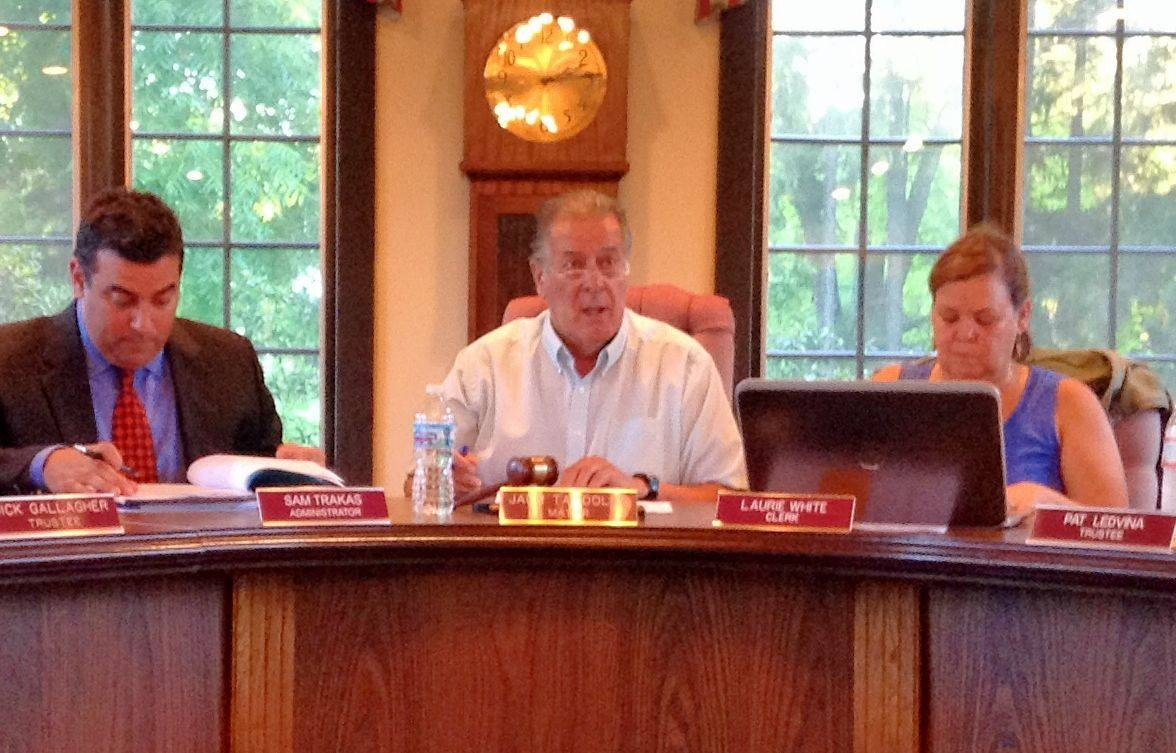 Inverness Mayor Jack Tatooles, center, speaks during the board meeting Tuesday night while Village Administrator Sam Trakas and Village Clerk Laurie White listen.
