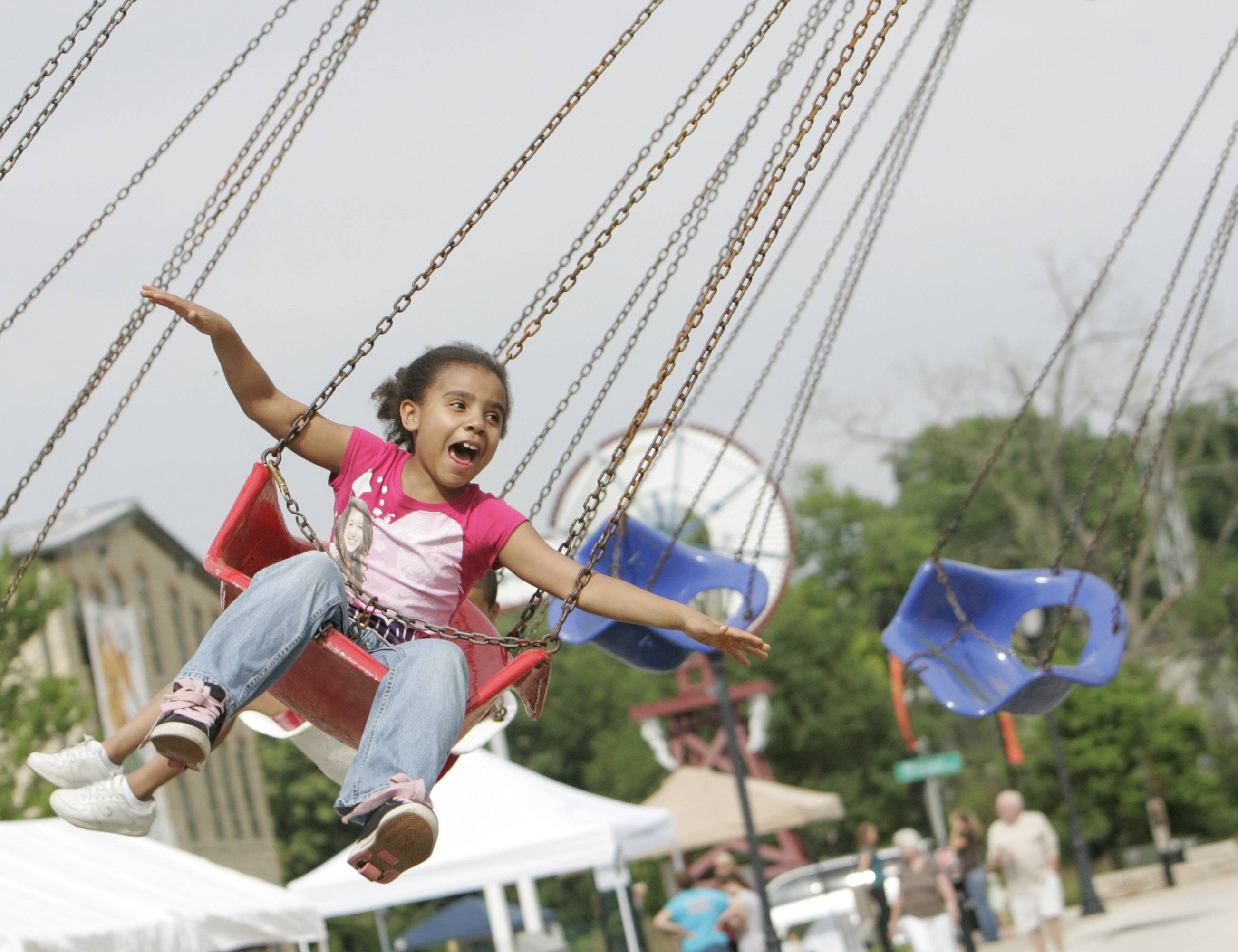 Tykeya Munger, 8, of Aurora enjoys a carnival ride at a previous Batavia's Windmill City Festival. This year's fest opens 6 p.m. Thursday and runs through Sunday, July 10-13. Find a full schedule of festival events on Page 3.