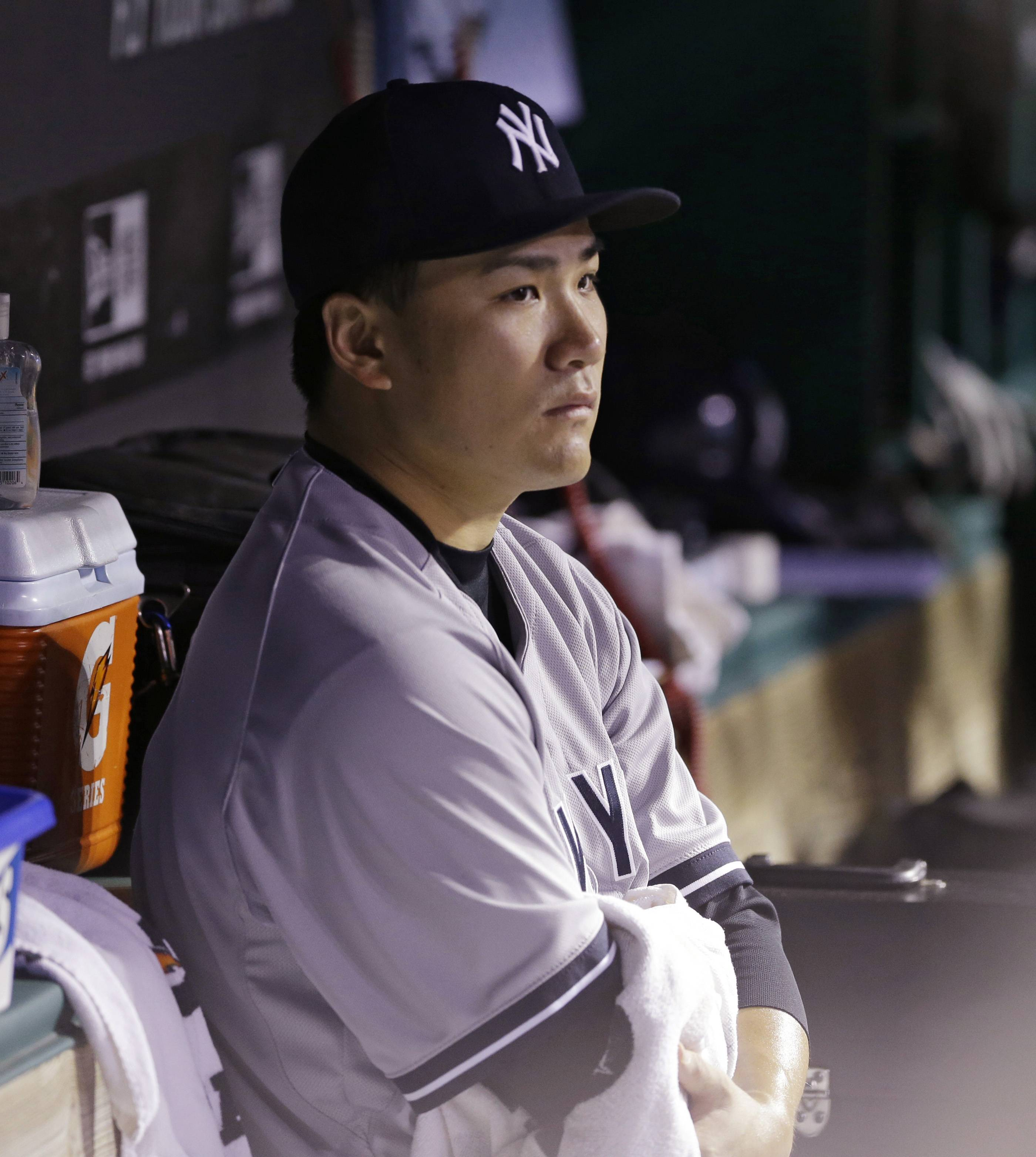 New York Yankees starting pitcher Masahiro Tanaka watches from the dugout after leaving the game in the seventh inning of a baseball game against the Cleveland Indians Tuesday, July 8, 2014, in Cleveland. Tanaka pitched 6 2/3 innings and gave up 10 hits and five runs.