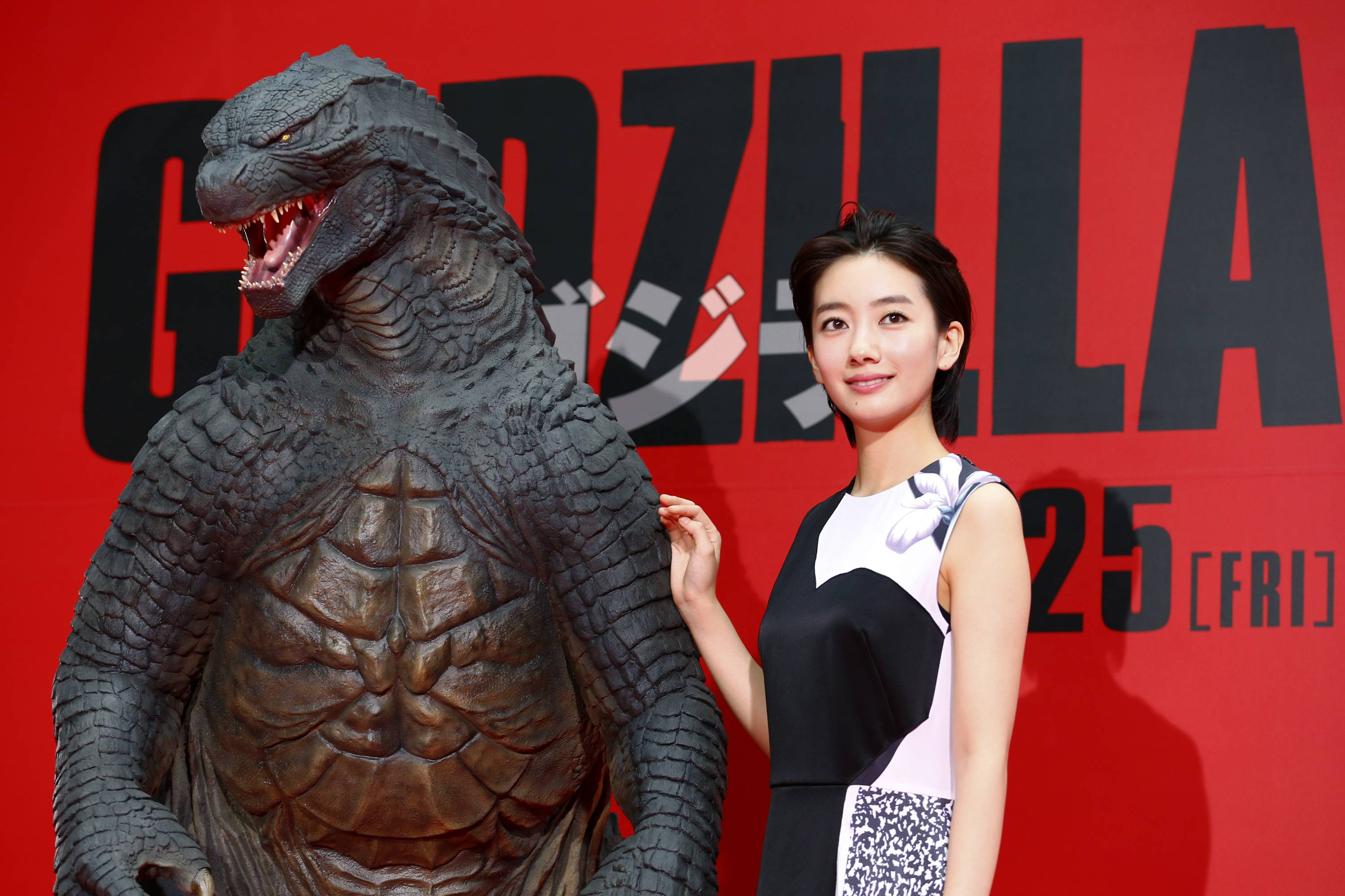 "Japanese actress Haru poses for photographers during the Japan premiere of ""Godzilla"" in Tokyo, Thursday."