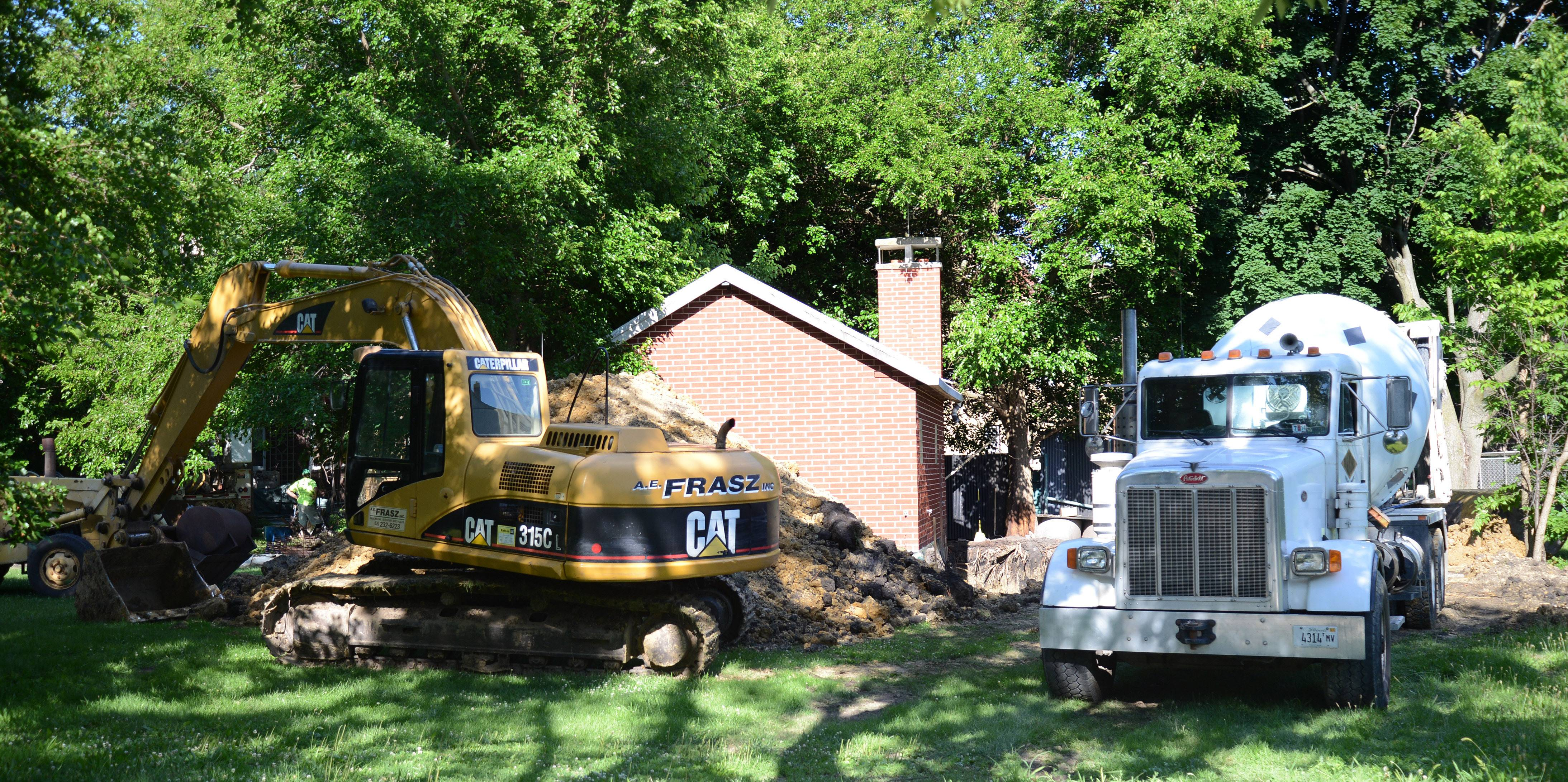 Construction work being done on the property of Cliff McIlvaine is not in complete compliance with an agreement signed with the city of St. Charles, a city attorney says. McIlvaine's attorney disagrees.