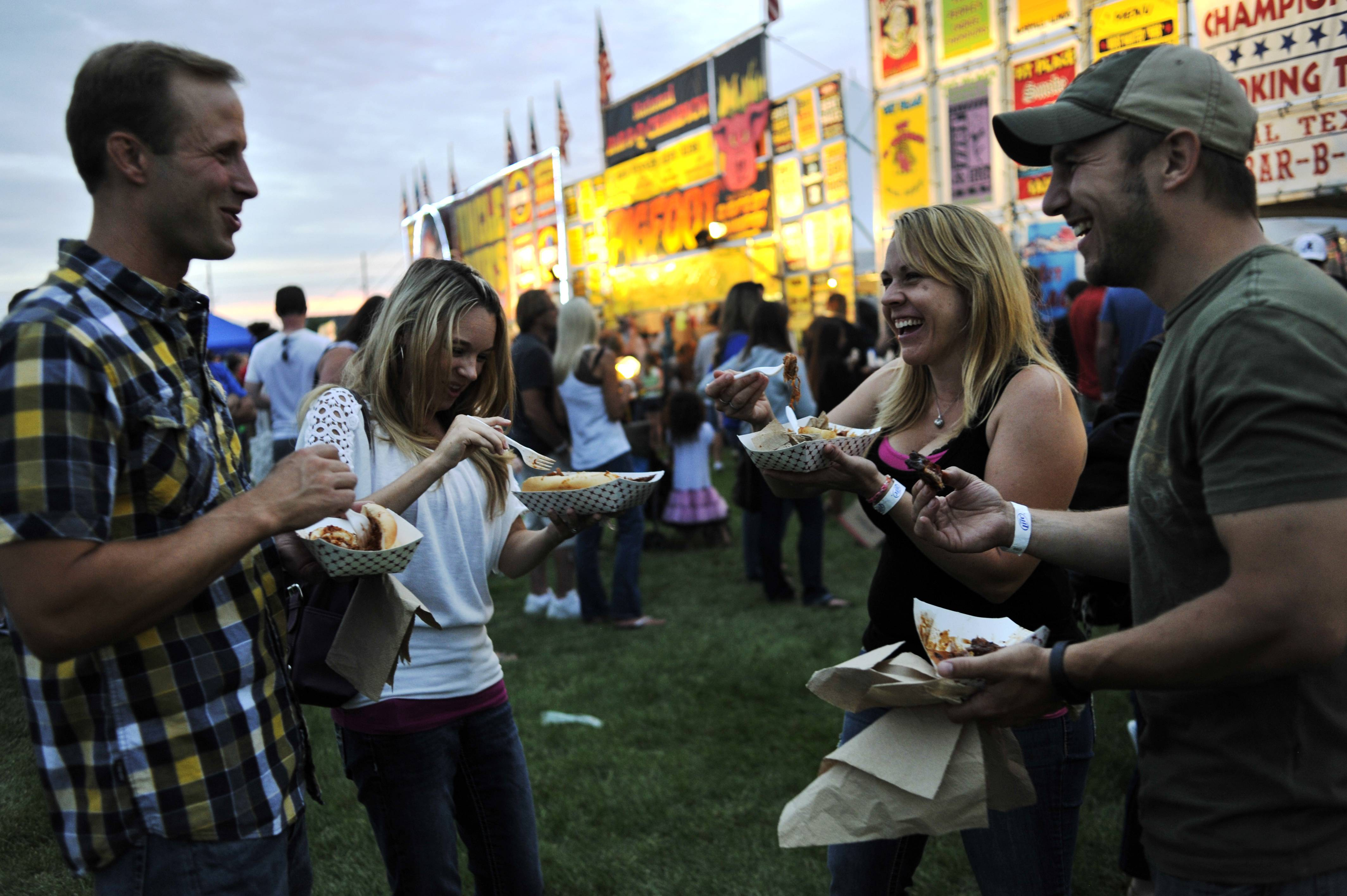 Michael and Jennifer Hodge of Cary enjoy barbecue with their friends Serene and Butch Berkowitz of Lake in the Hills, left to right, at the Rockin' Ribfest in Lake in the Hills on Friday. Festival hours are from 11:30 a.m. to 11 p.m. today and from 11:30 a.m. to 7 p.m. Sunday. Visit lithribfest.com for more.