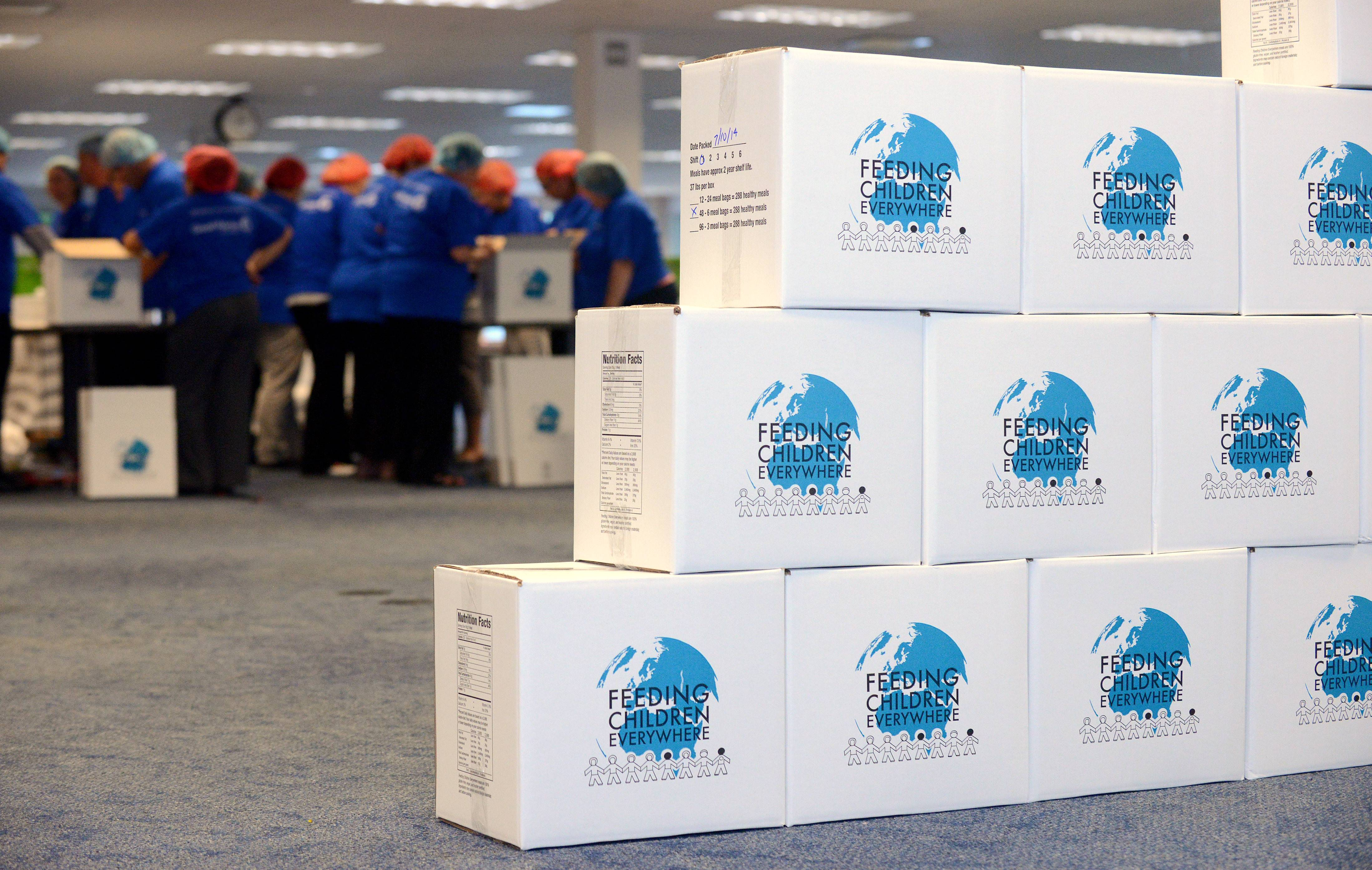 Filled boxes of food prepared for the Food for Greater Elgin pantry are stacked up as the first of two volunteer shifts ends Thursday. For the second year, Chase employees packed 30,000 meals for area families in need at the bank's Elgin credit card services facility.