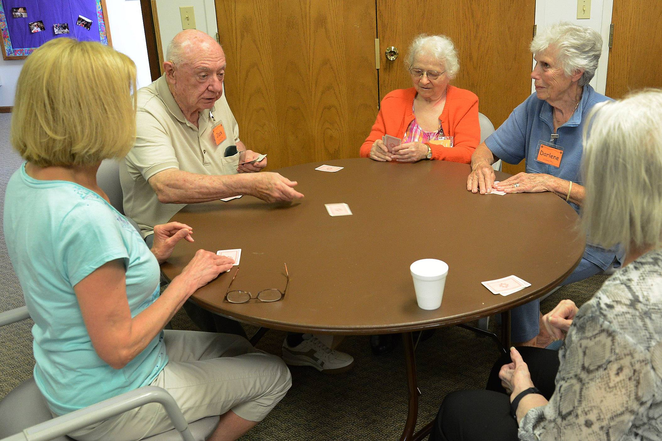 Jack Ryan deals a hand to, from his left, Rita Hussey, volunteer Darlene Greaves, Dee Grabe and volunteer Margie Ewart.