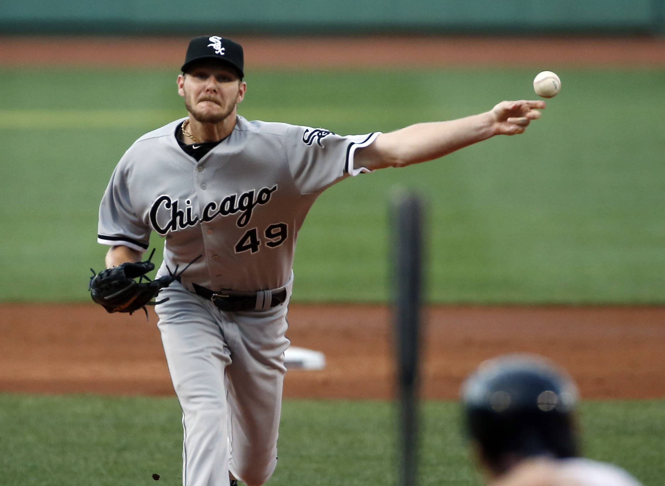 Chicago White Sox starting pitcher Chris Sale delivers to the Boston Red Sox in the first inning of a baseball game at Fenway Park in Boston, Wednesday, July 9, 2014.
