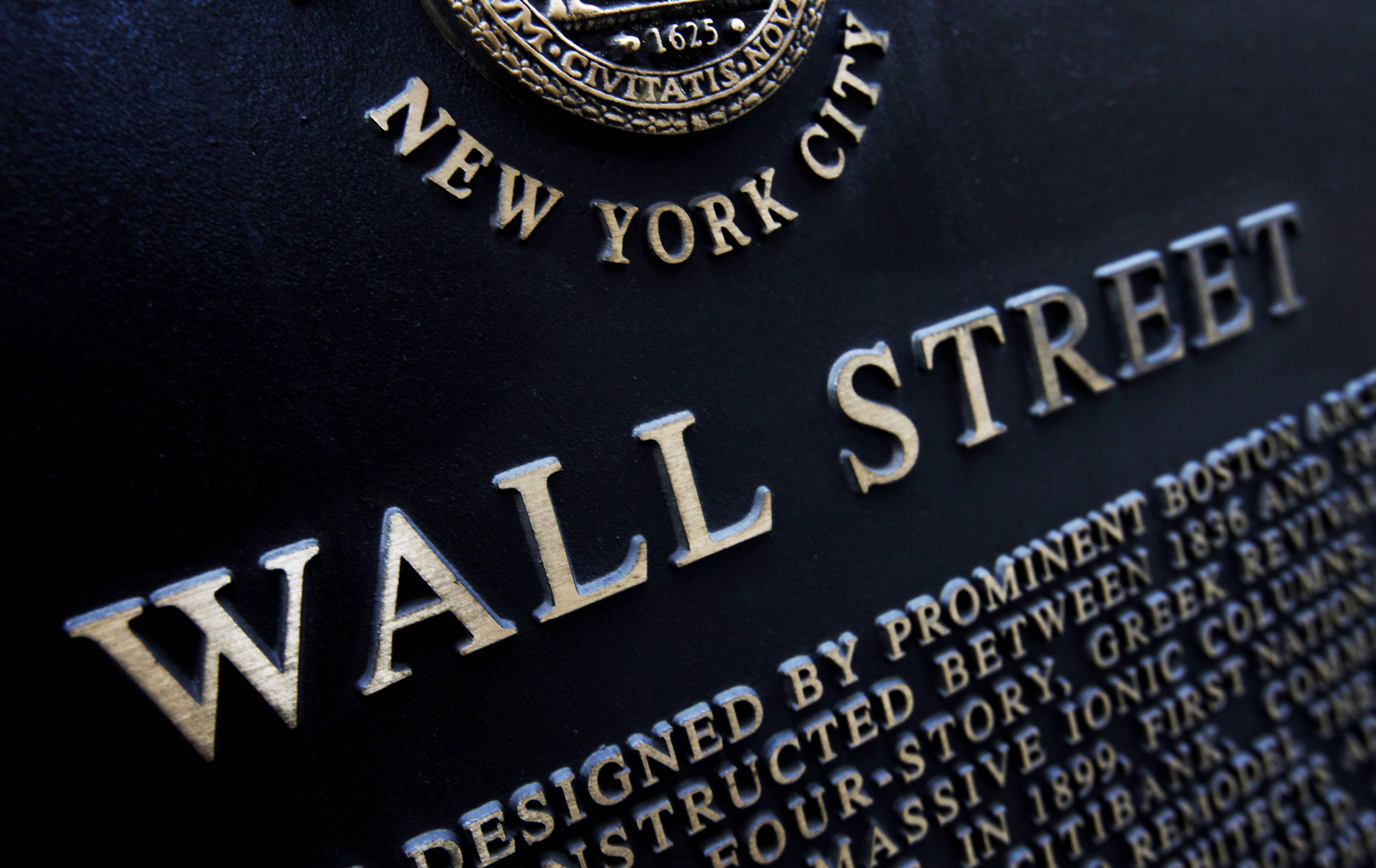 Associated Press/Jan. 4, 2010 An historic marker on Wall Street in New York. U.S. stocks ended the week a little lower.