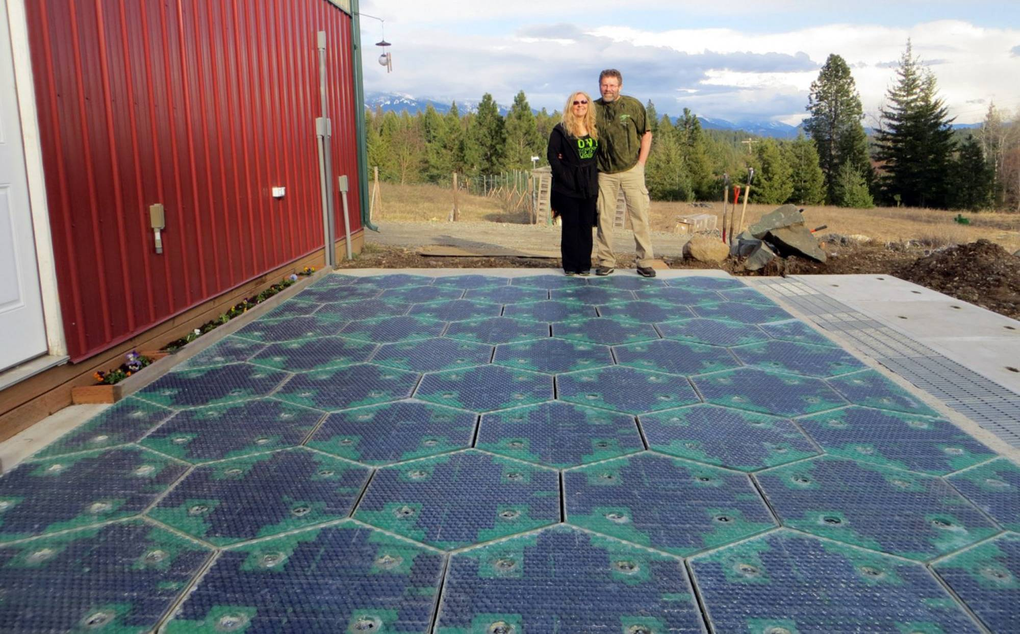 Solar Roadways, Scott and Julie Brusaw on a prototype solar-panel parking area at their company's business in Sandpoint, Idaho.