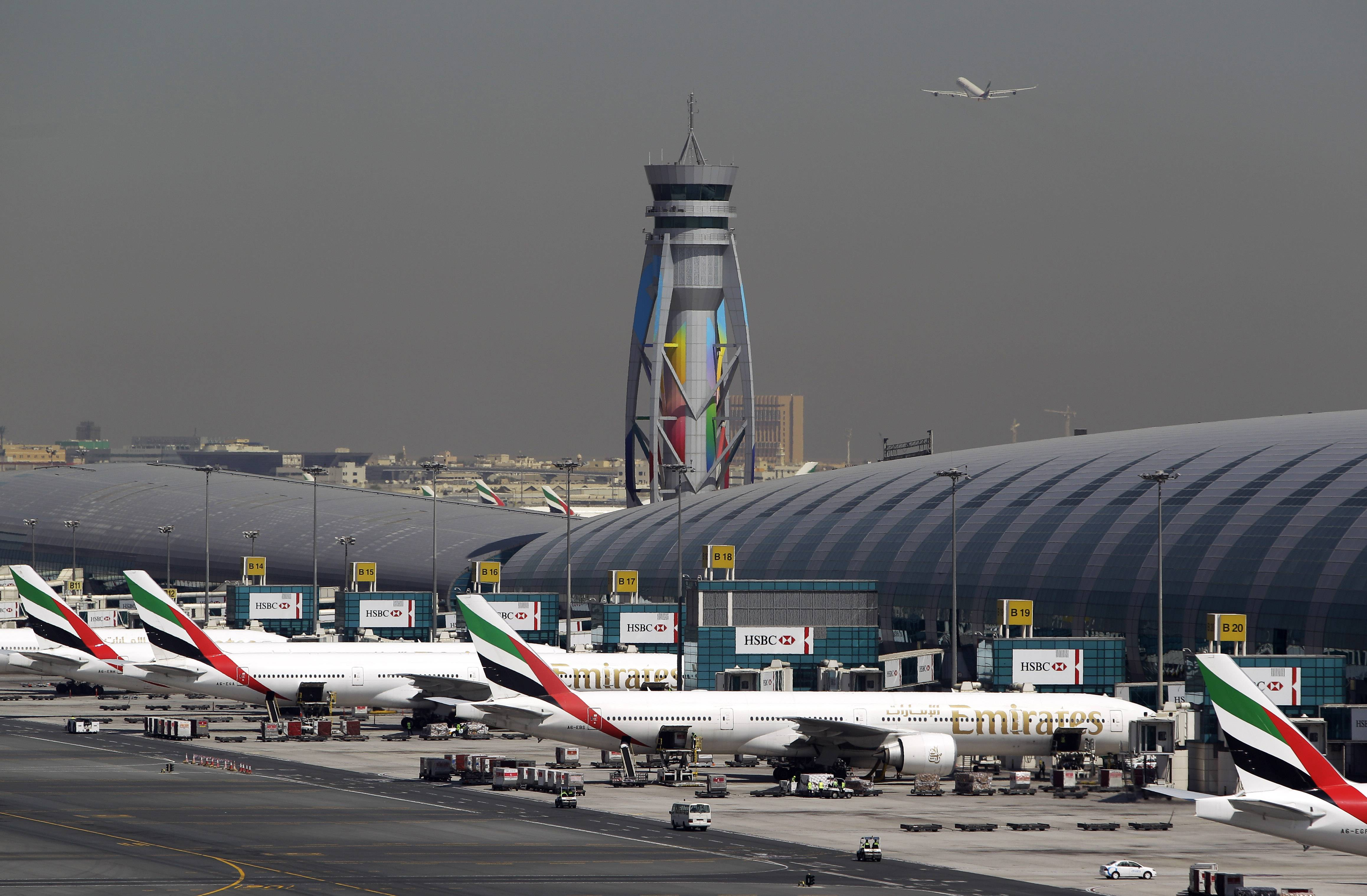 Emirates passenger planes parked at their gates at Dubai Airport in United Arab Emirates. Now that he's had a taste of running the world's busiest air hub for international passengers, the airport's CEO, Paul Griffiths, is determined to hang on to the honor while setting his sights on an even bigger prize: beating Atlanta for the title of busiest airport on the planet.