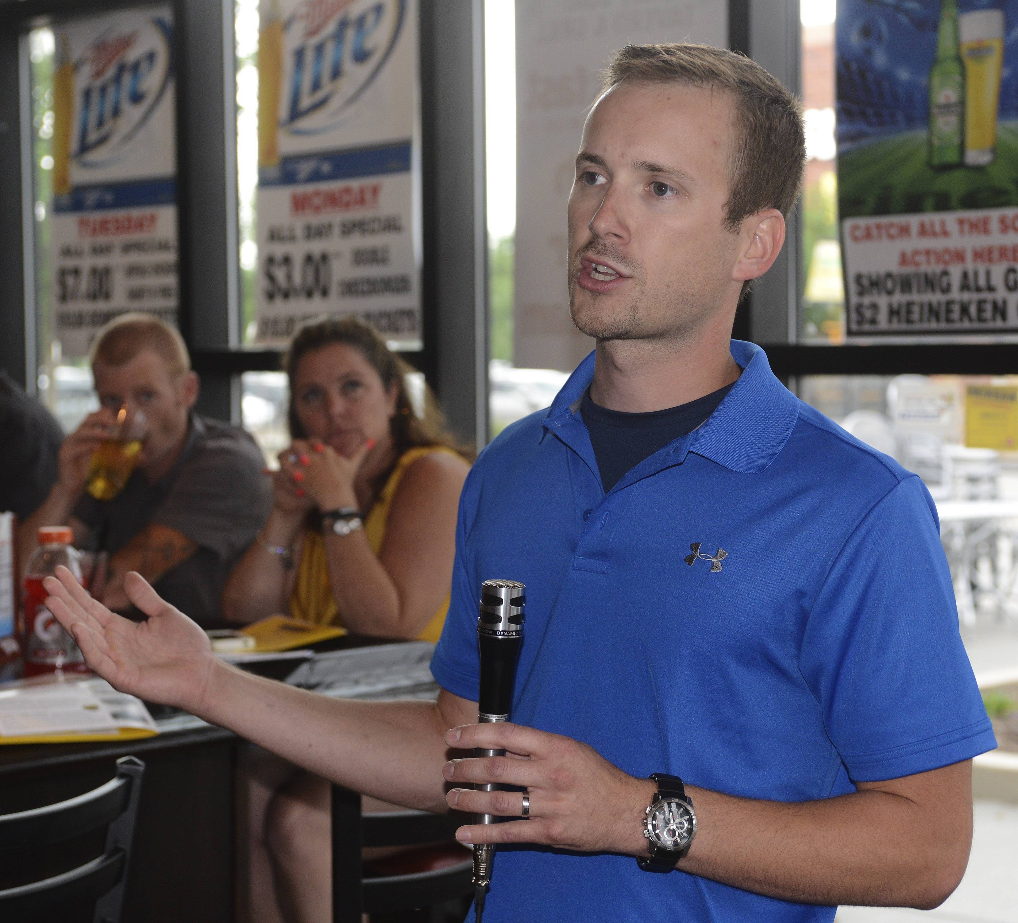 Daily Herald auto columnist Matt Avery speaks during a combination car show/Daily Herald subscriber event recently at the Billy Goat at Randhurst Village in Mount Prospect. Avery was named a silver medalist in the 2013 International Automotive Media Awards.