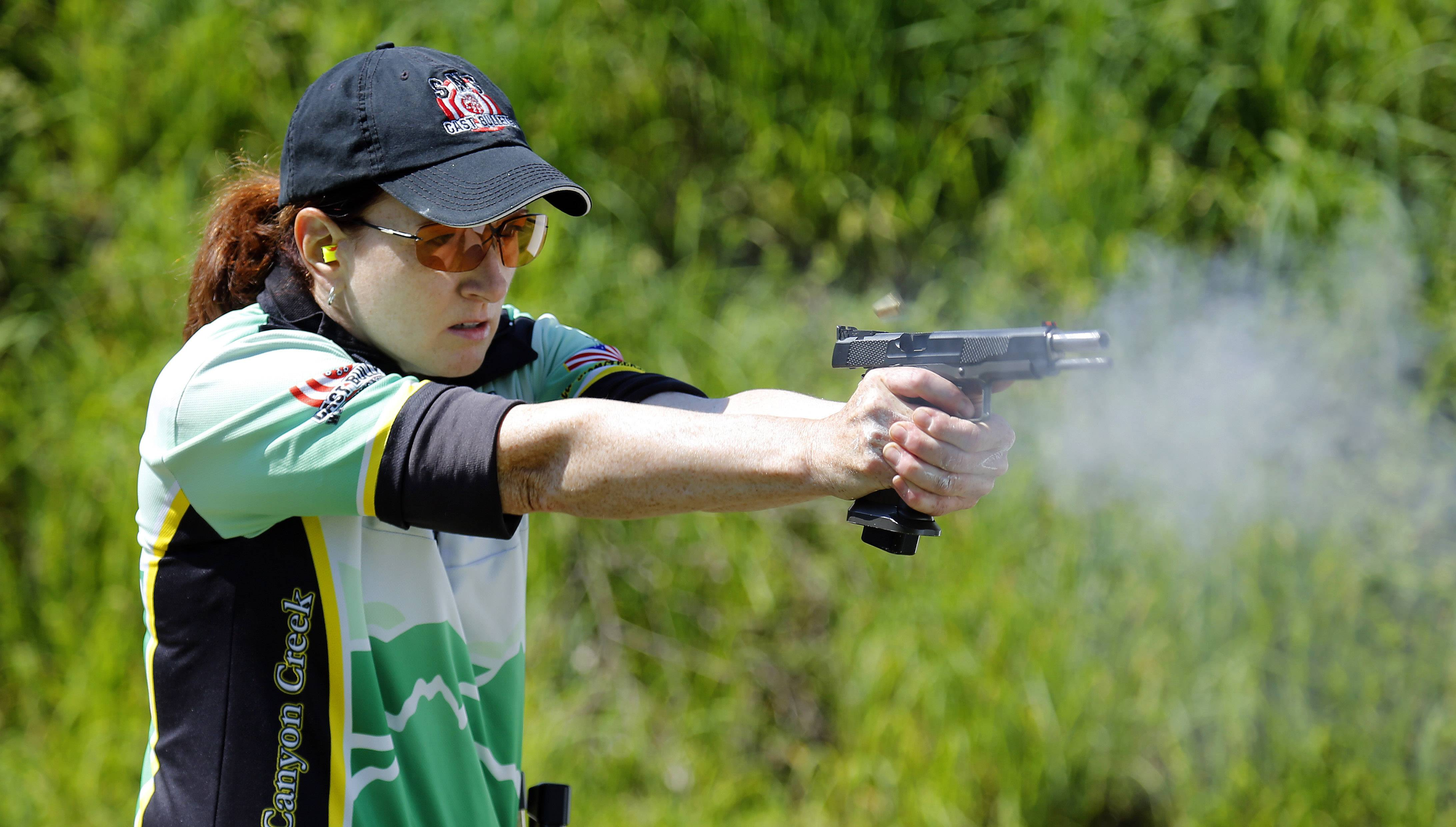 TD Roe concentrates as she shoots at targets during a recent competition at the Oak Park Sportsmen's Club in Plainfield.
