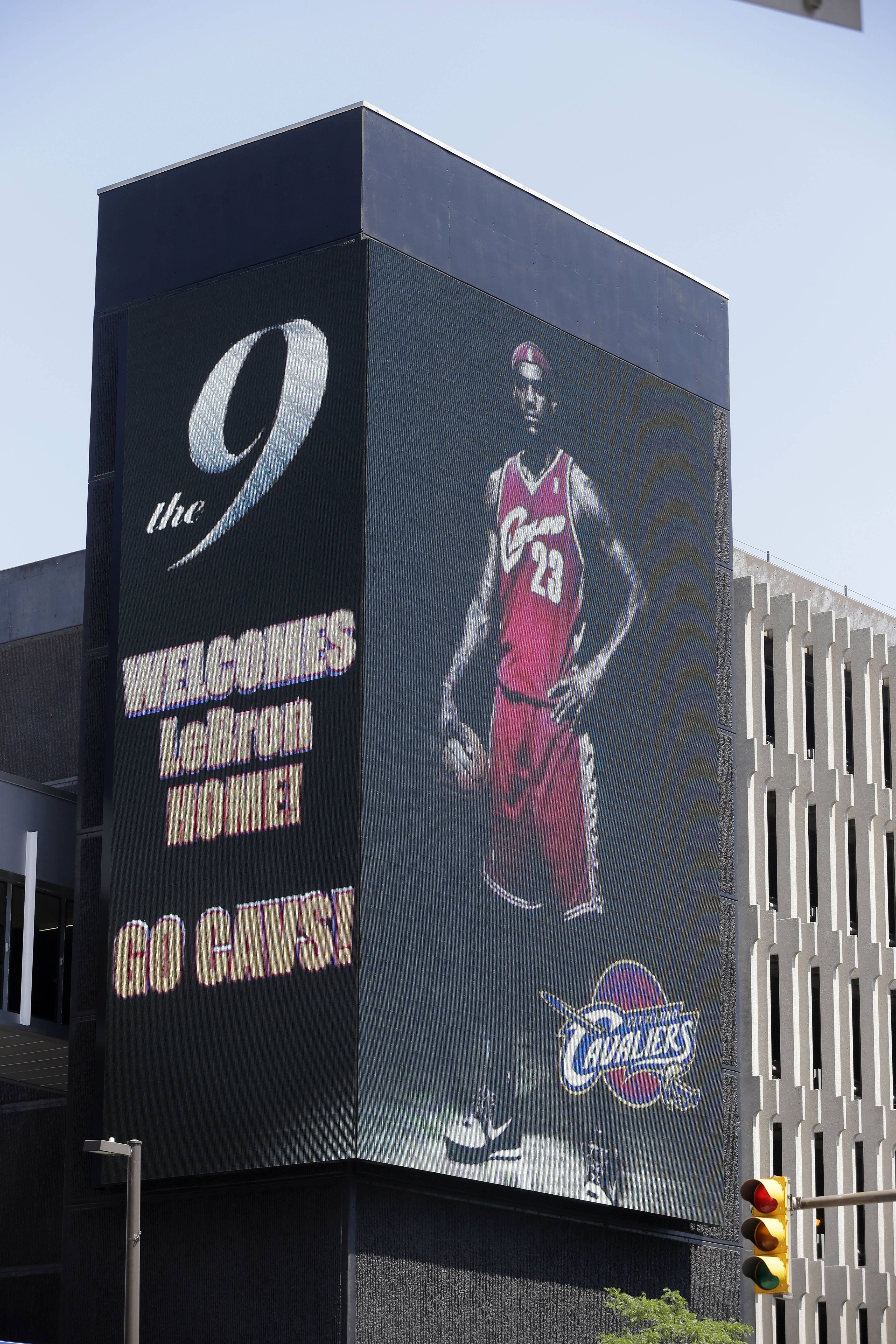 A large electronic billboard in Cleveland welcomes back NBA basketball star LeBron James Friday, after he announced he would return to the Cleveland Cavaliers after four years with the Miami Heat.