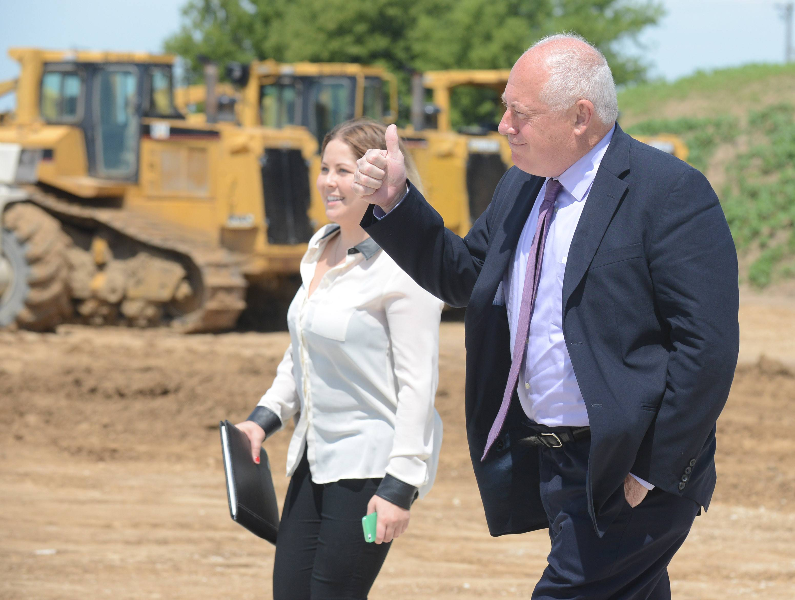 Gov. Pat Quinn gives a thumbs-up to attendees as he arrives for the Weber-Stephen Products groundbreaking ceremony in Huntley on Friday.
