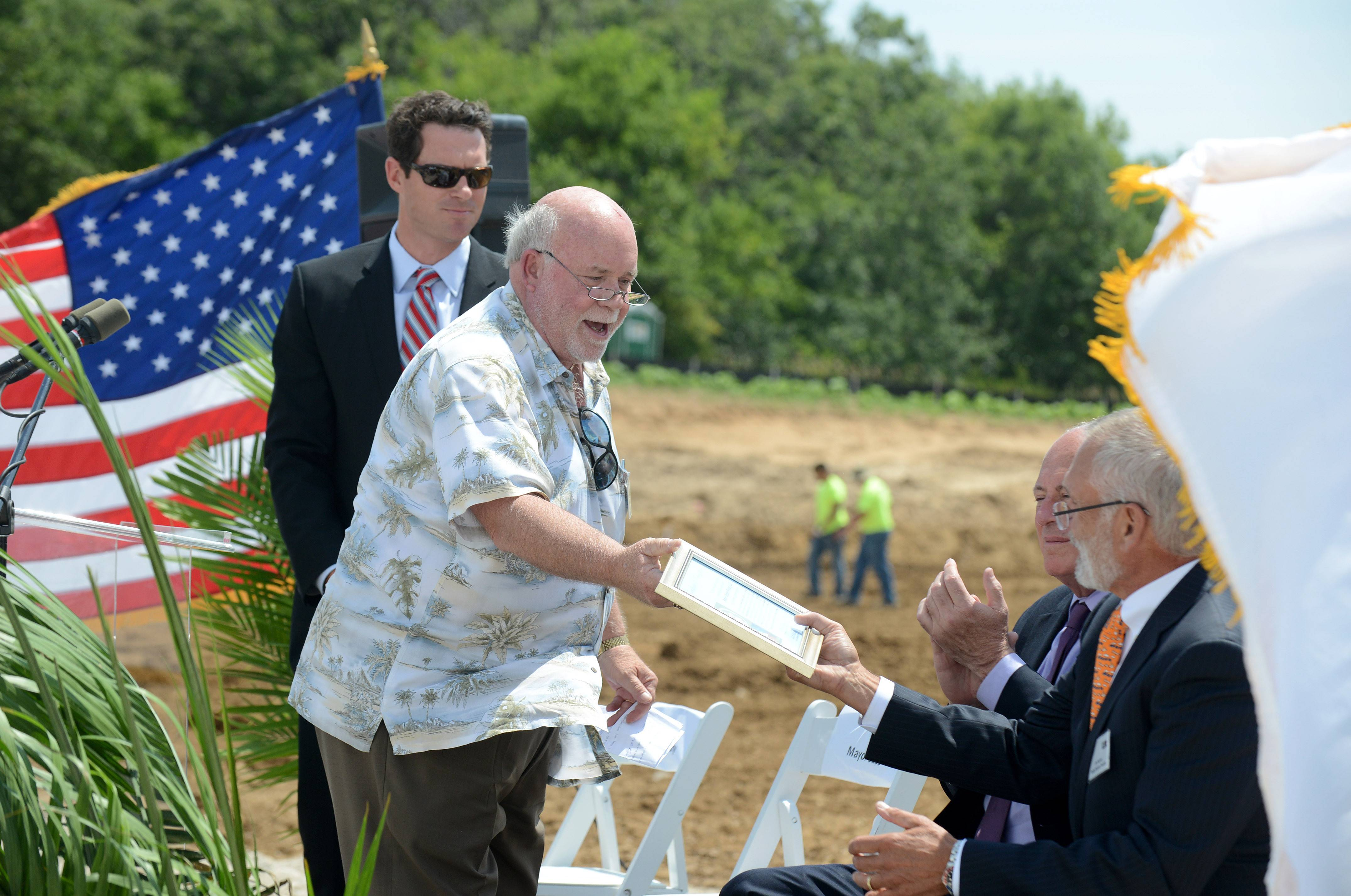 Huntley Mayor Charles Sass presents Weber-Stephen Products Executive Chairman James Stephen with a certificate of recognition at the groundbreaking event for the company's new global distribution center in Huntley on Friday.
