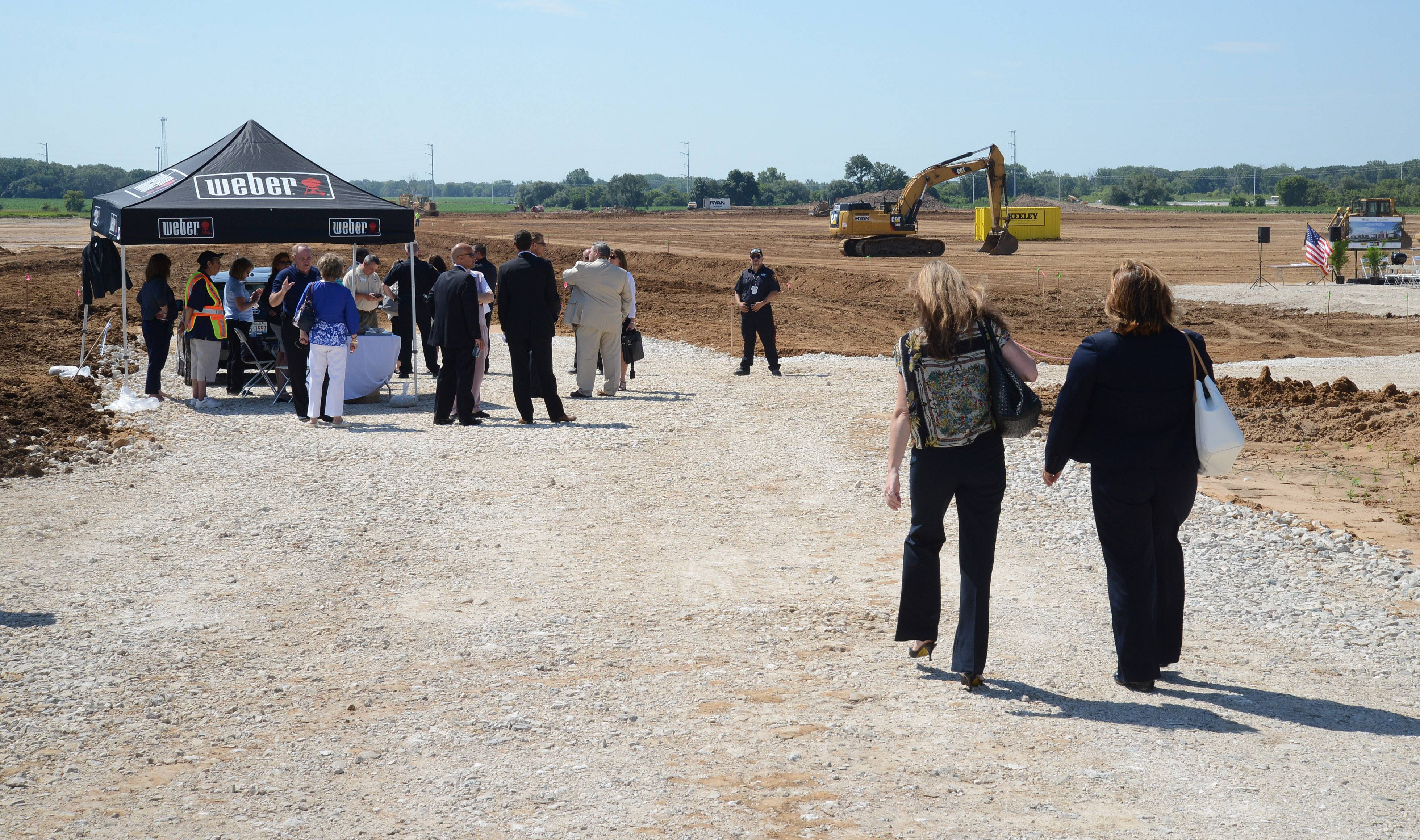 Visitors begin to arrive for the groundbreaking ceremony of Weber-Stephen Products' new global distribution center on Freeman Road in Huntley on Friday.