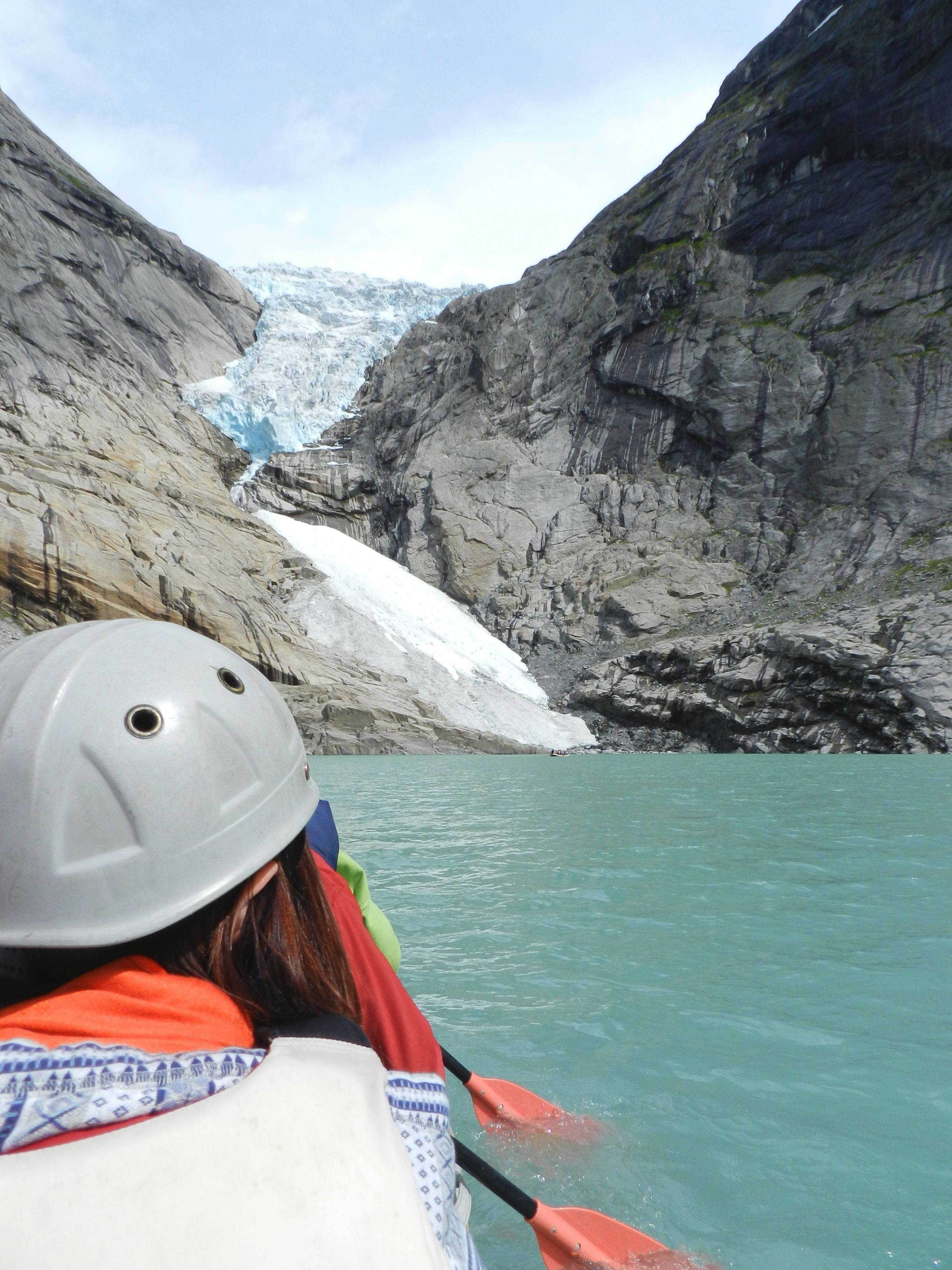 Learning firsthand about climate change as we paddle up to the receding Briksdal glacier.