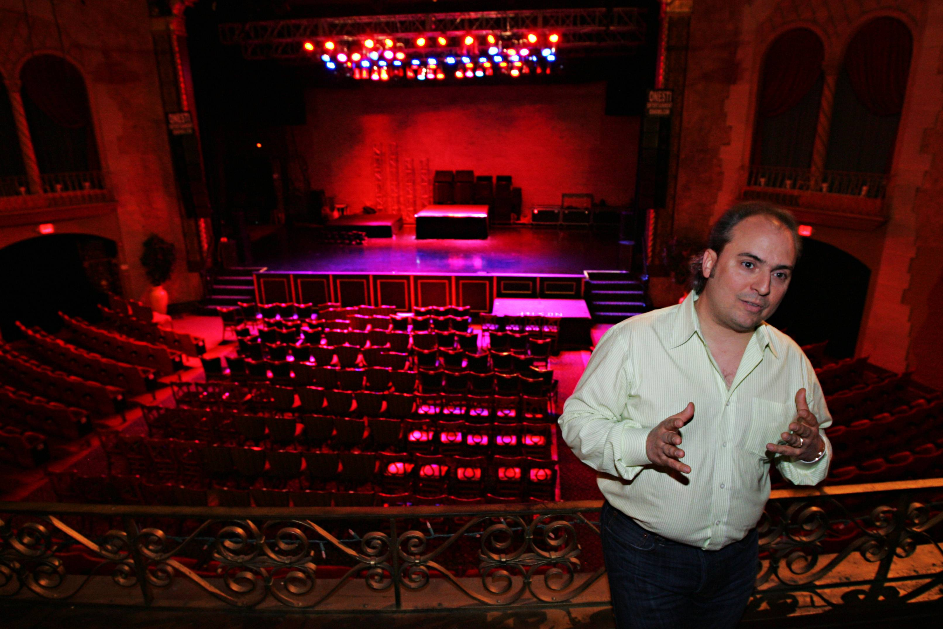 Christopher Hankins/chankins@dailyherald.com ¬ Arcada Theater owner Ron Onesti has been able to consistently bring top acts to the venue, despite it's location in the far-western suburbs.