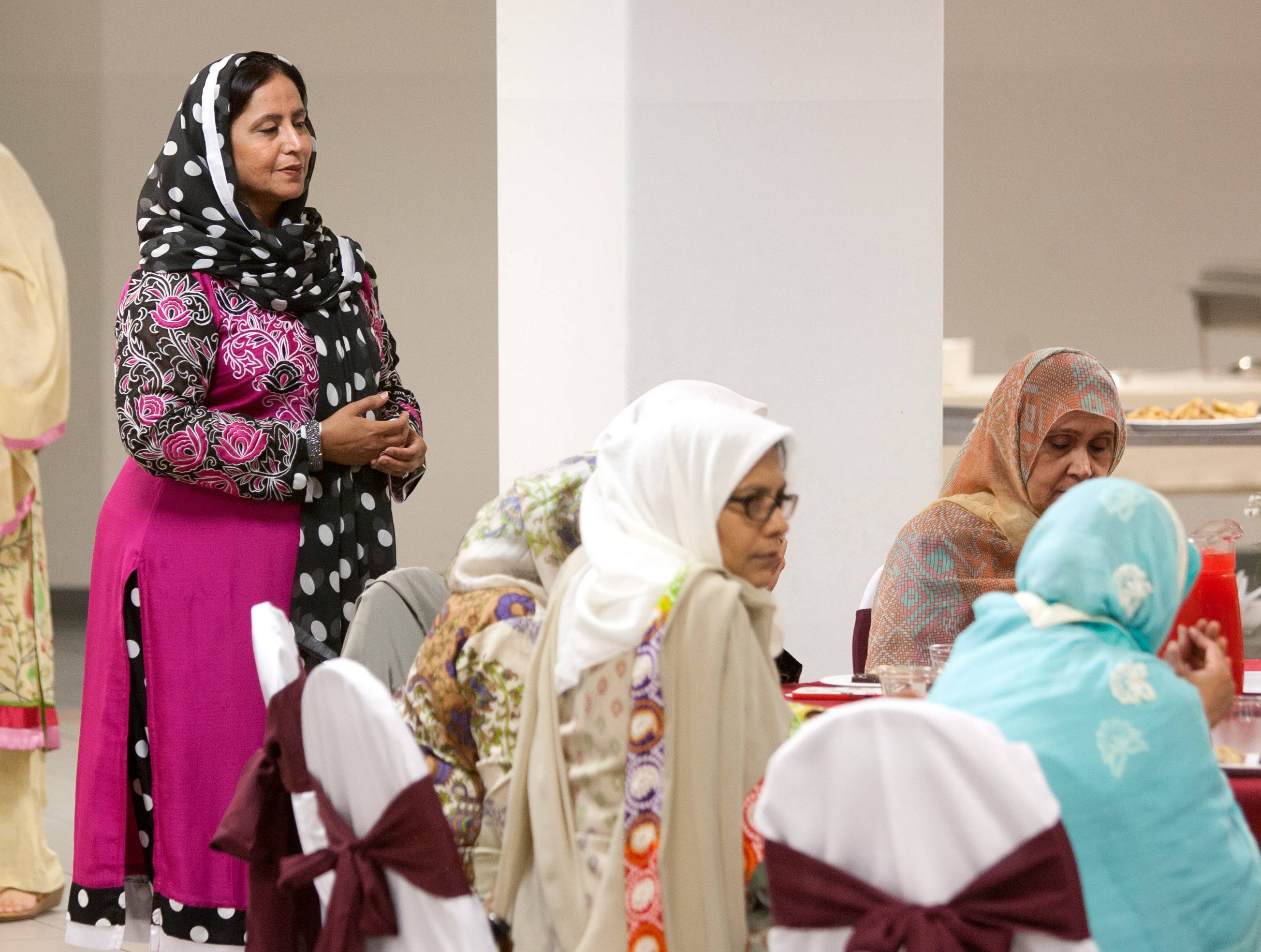 Sameena Shoukathullah, left, prays during a breaking of the fast Friday in celebration of Ramadan at the Islamic Foundation in Villa Park.