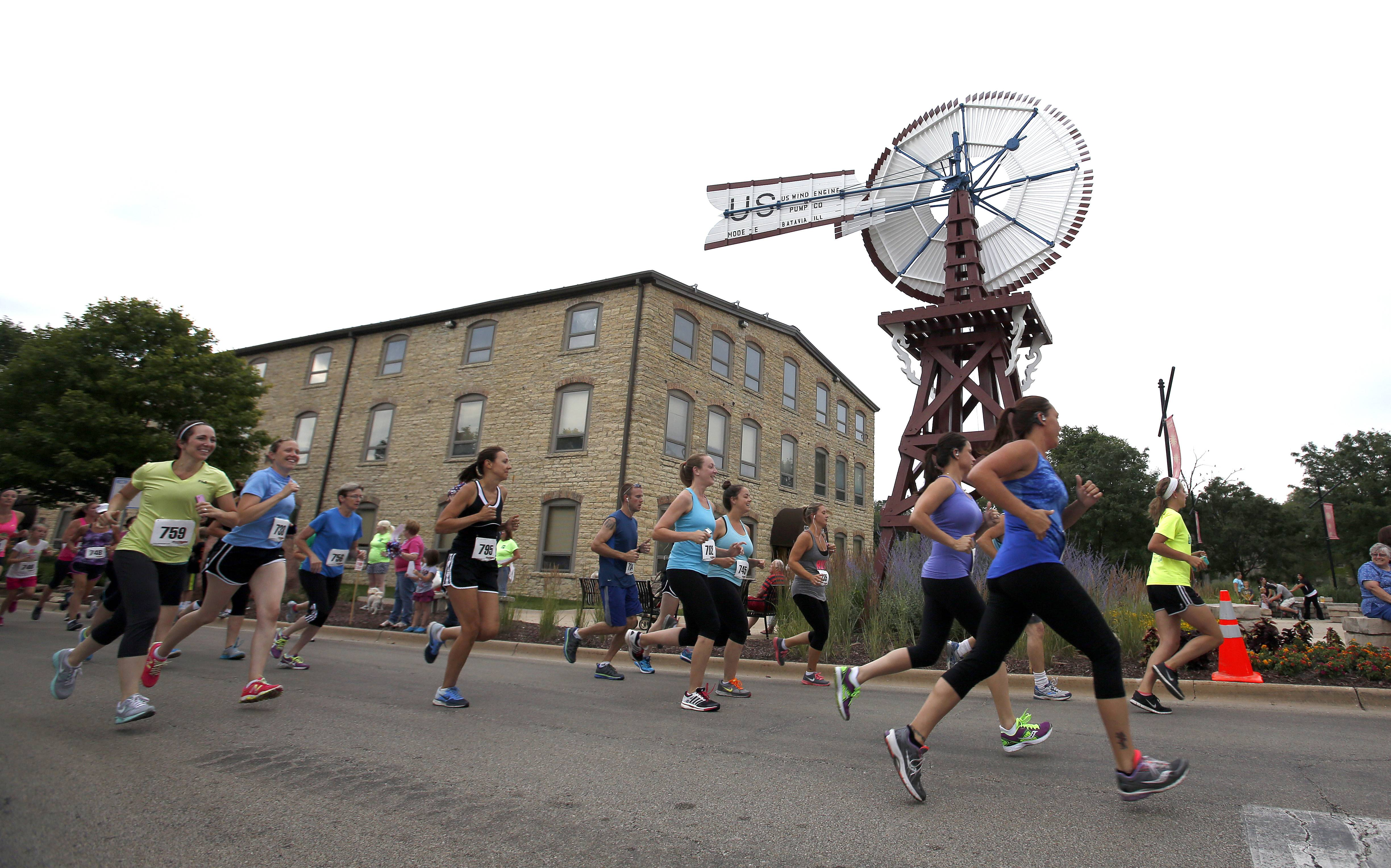 Racers turn the first corner during the Windmill Whirl 5k race Friday at the Windmill City Fest in Batavia. The festival runs through Sunday. Visit windmillcityfest.org for more information.