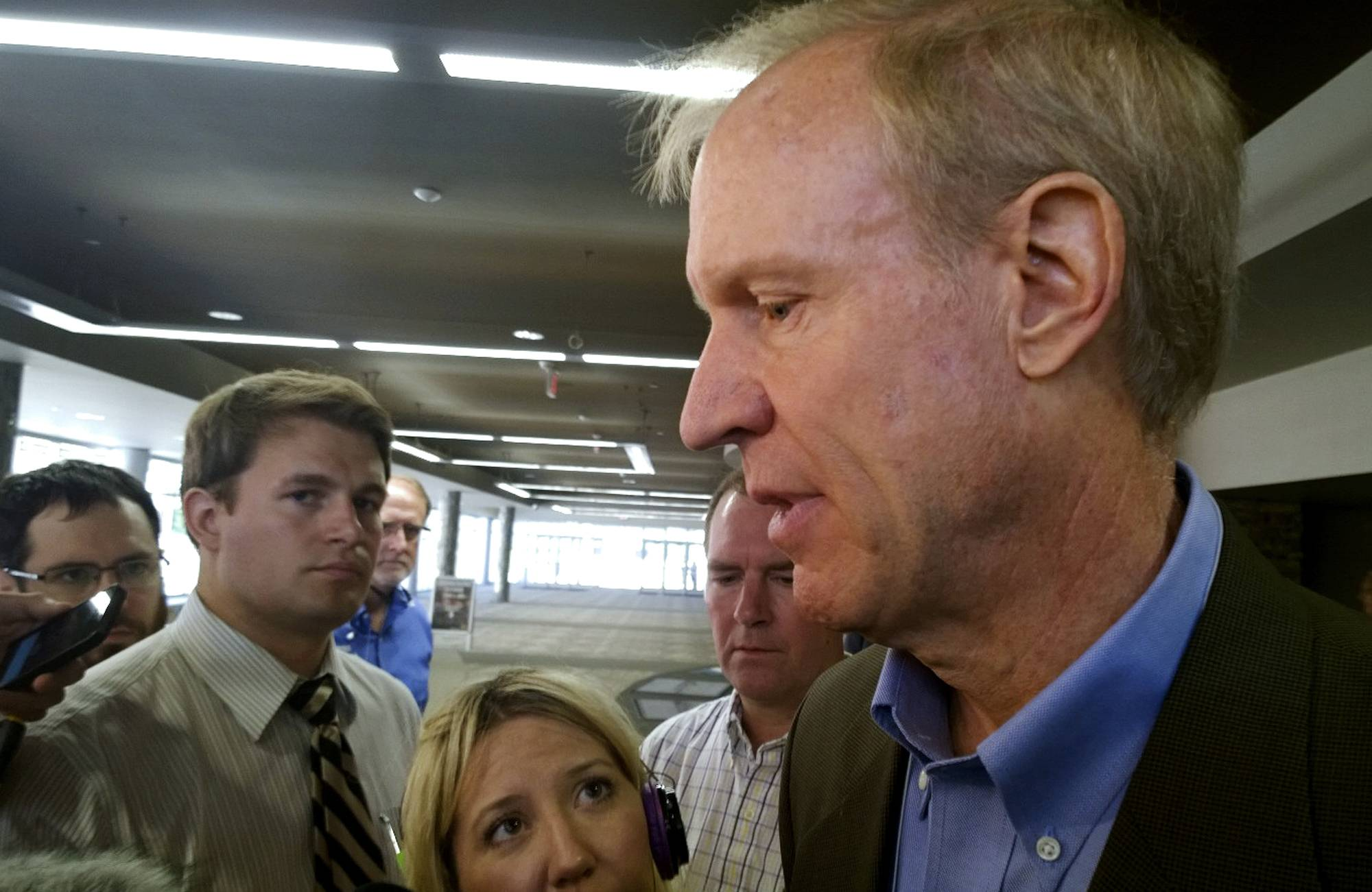Republican governor candidate Bruce Rauner answers questions from reporters Friday in Springfield. He says Gov. Pat Quinn is hiding from questions on his anti-violence program.